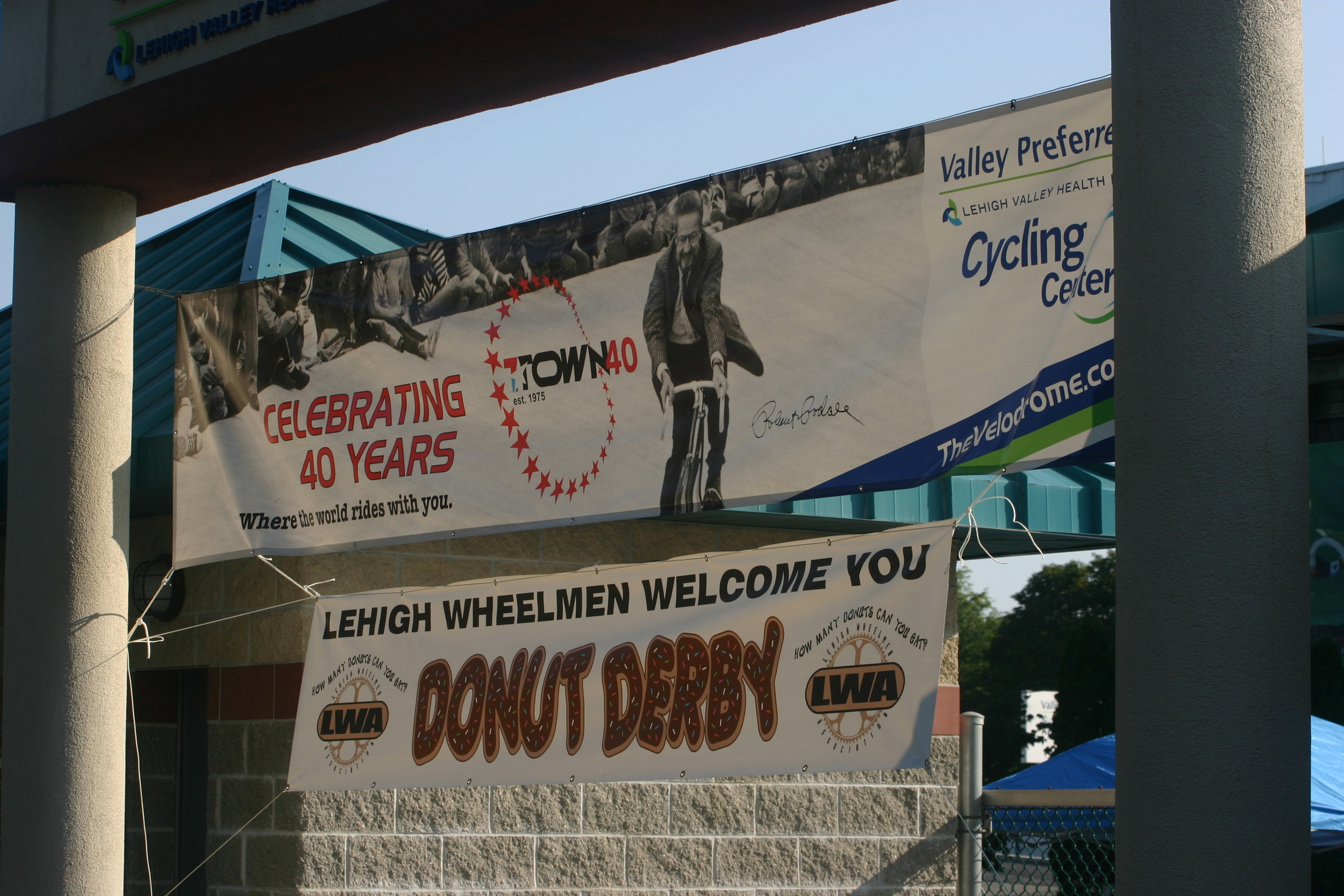 The 2015 Donut Derby banner hanging in front of the cobbled crater of the Lehigh Velodrome. Photo courtesy Chuck Rudy.