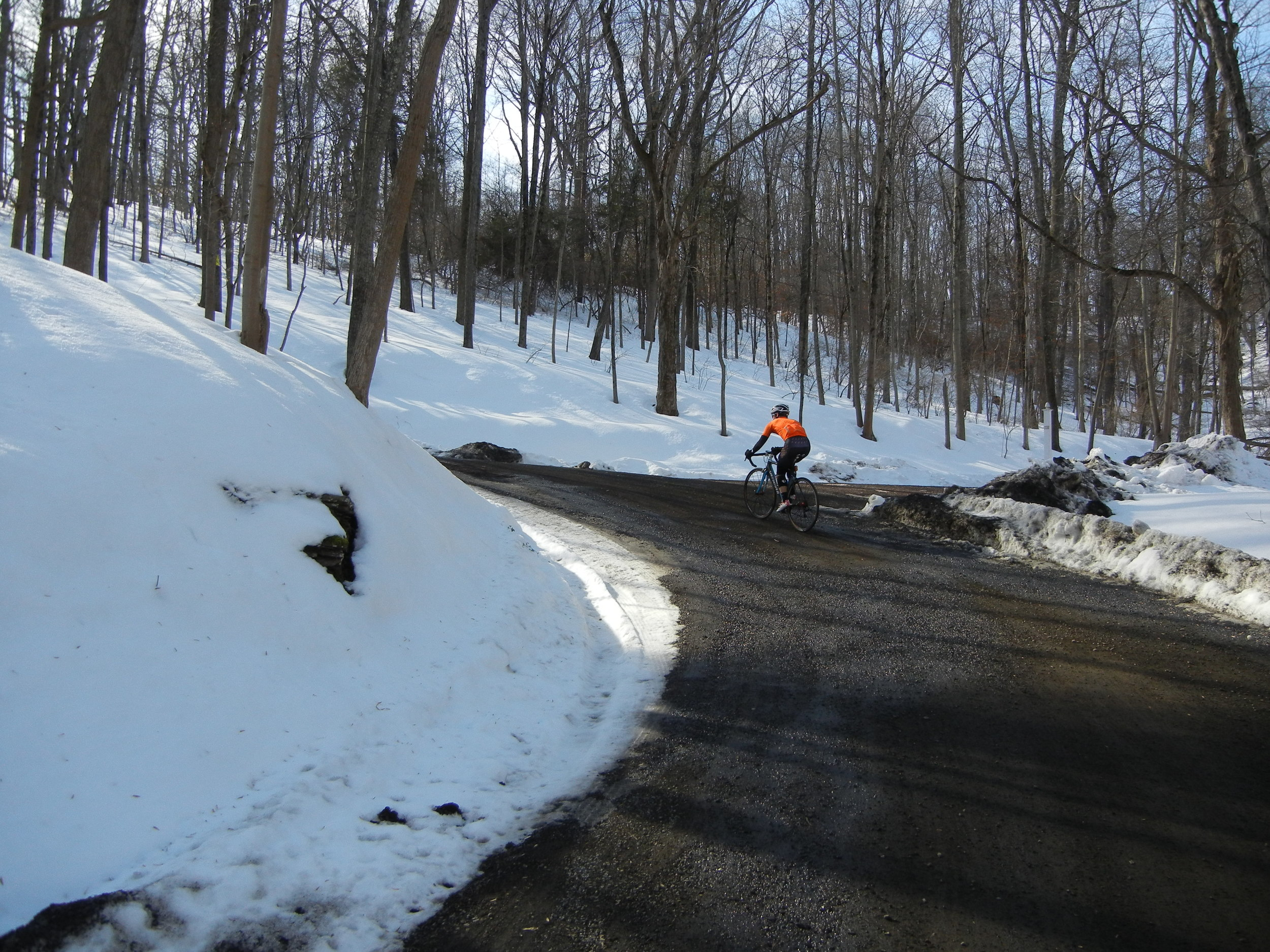 It's quite difficult to capture the steepness of this climb whilst riding. It's even more difficult to tackle a steep gravel climb with a car coming down just behind the snow bank.