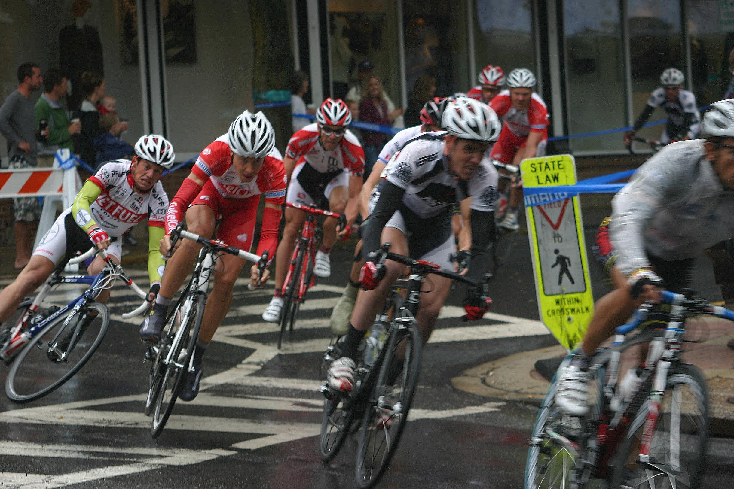 The 2010 Doylestown Criterium had the unfortunate combination of rain and painted roadways. Perhaps if they moved the pedestrain sign into the road things would have been safer. Photo courtesy Chuck Rudy.