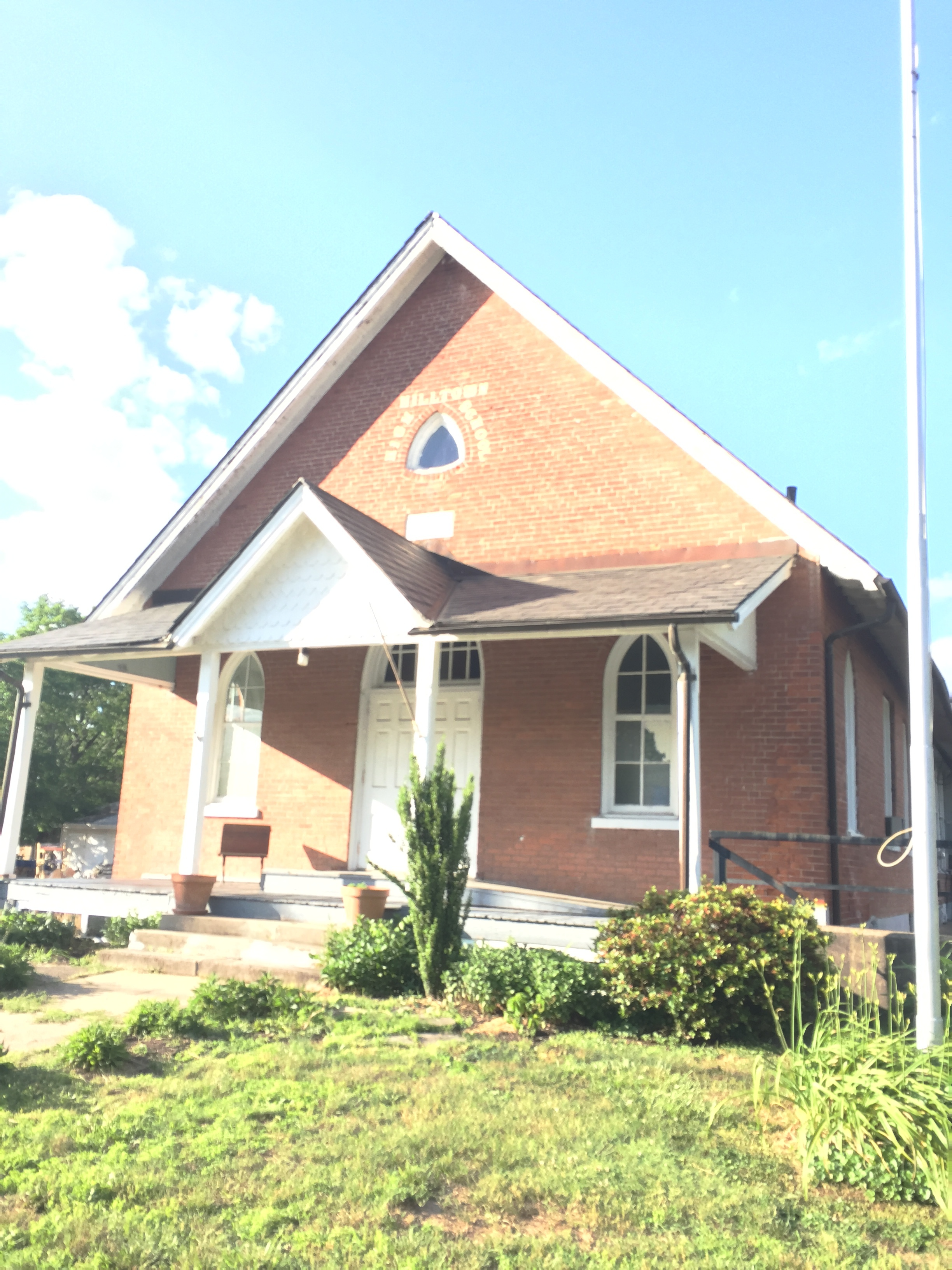 An easy schoolhouse to miss: The old Hilltown High School that started its life as a church takes its places amongst downtown Blooming Glen.