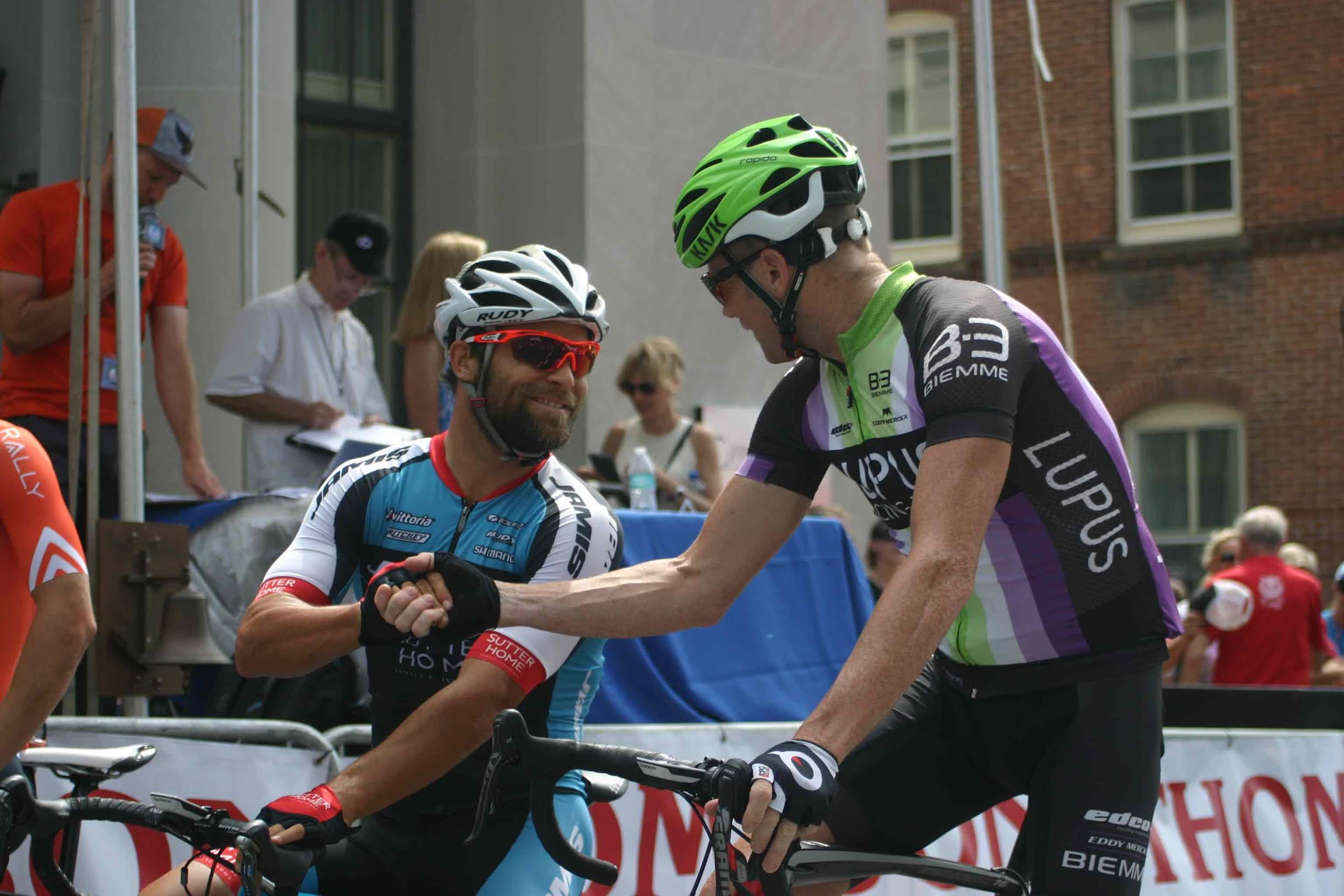 Last year's American Criterium Champion and last year's Bucks County Classic winner Eric Marcotte (left) and former WorldTour rider Chris Horner (right) share a handshake during the call-ups. Photo courtesy Chuck Rudy.