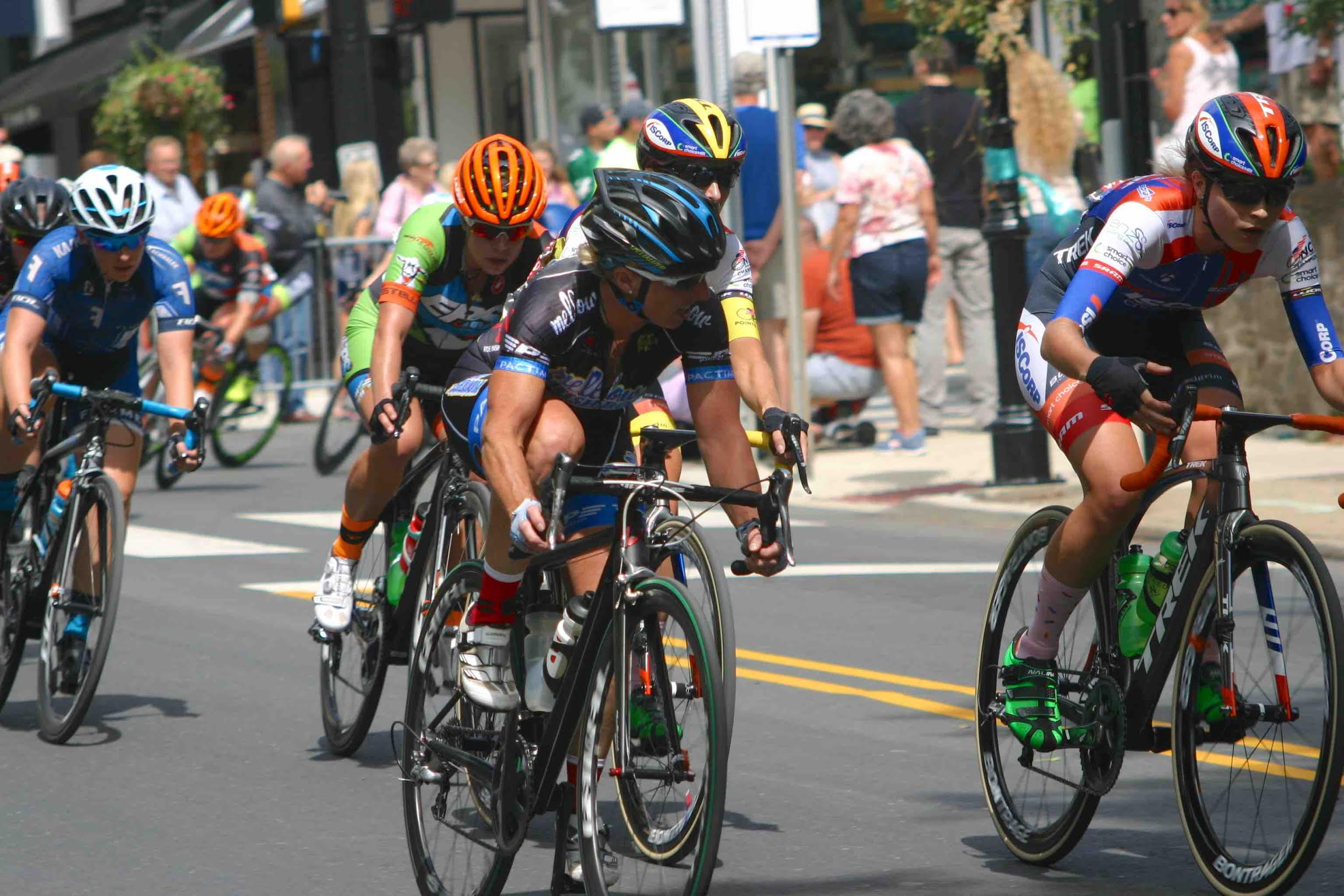 Laura Van Gilde, Mellow Mushroom Pizza Bakers p/b Van Dessel (center), takes a look to see who wants to help pull back the leaders. This is one of the fastest portions of the course. Photo courtesy Chuck Rudy.