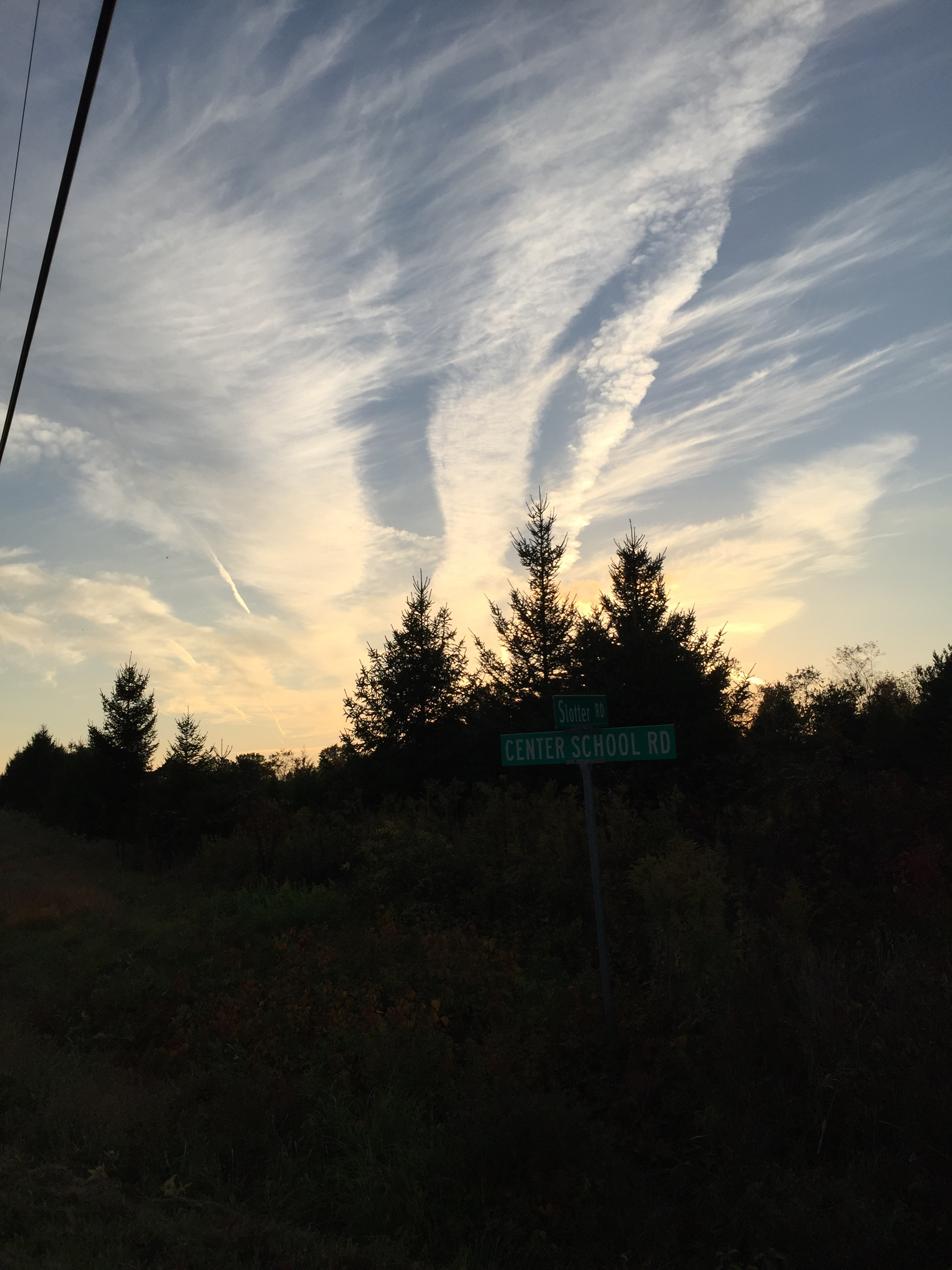 Fall sunsets streaked with contrails and thin clouds.