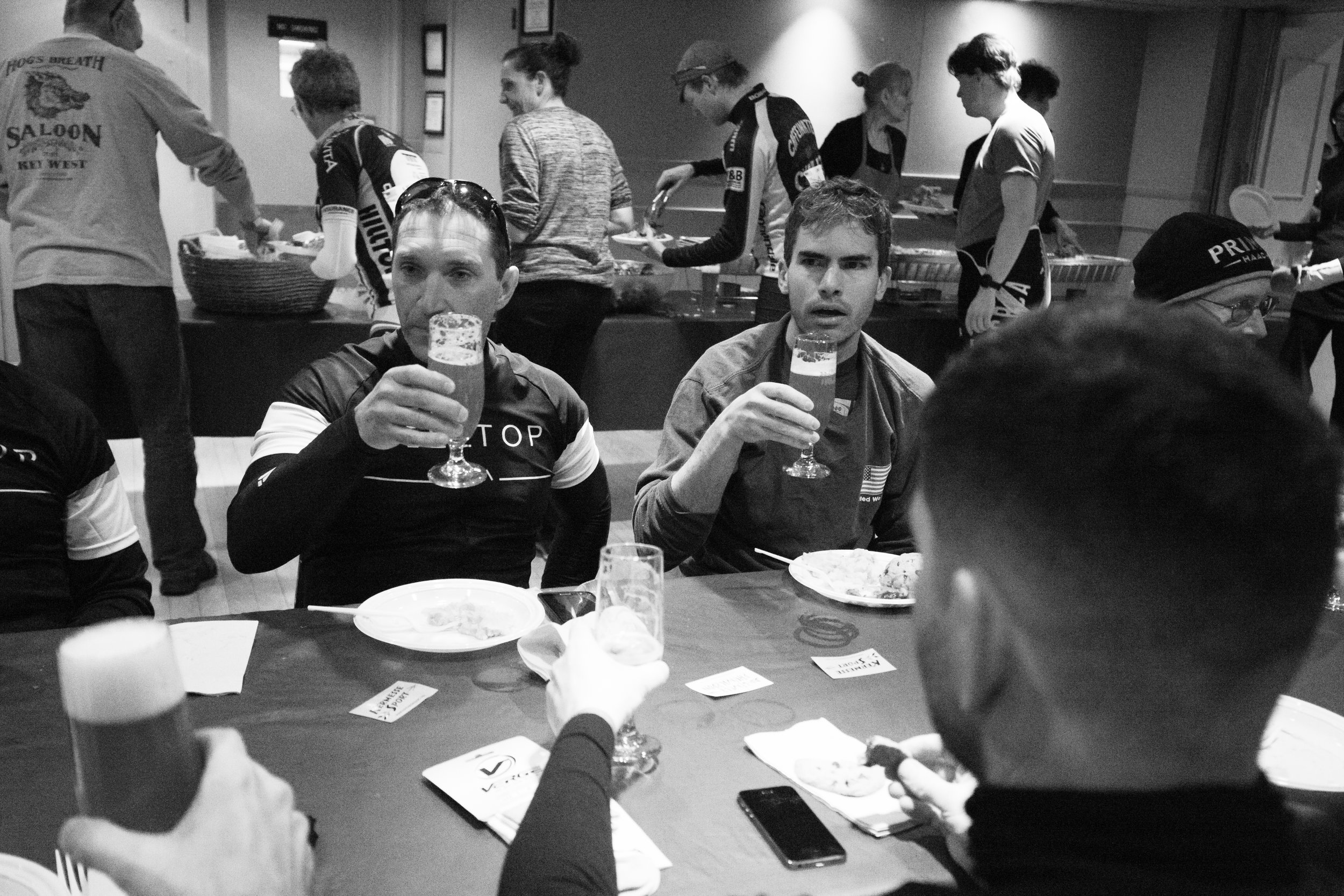 Finishers toasting to completing the Hell of Hunterdon in customized HoH beer glasses and the thousand-yard-stare. Photo by  Mike Maney Photography .