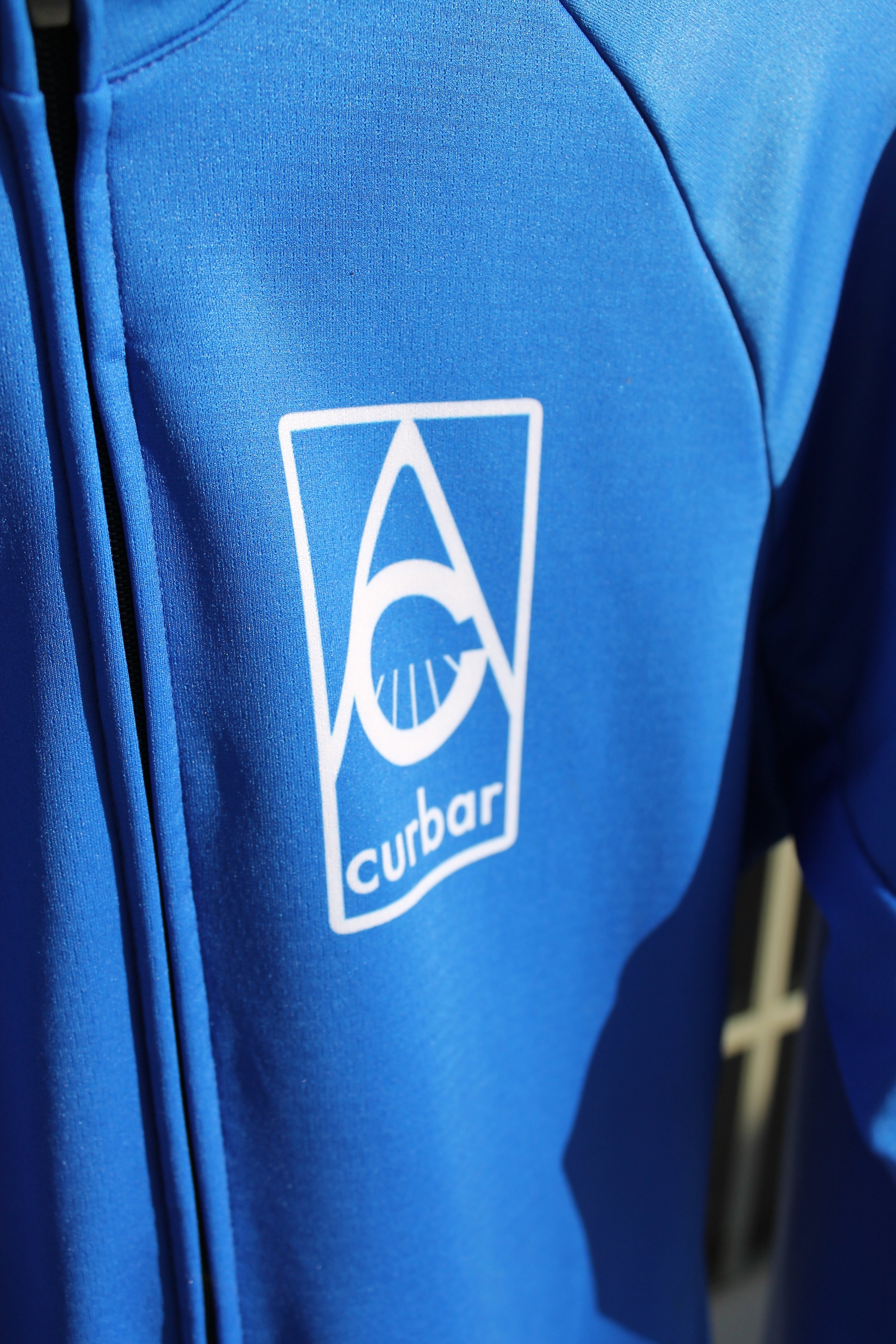 Curbar logo situated on the front left