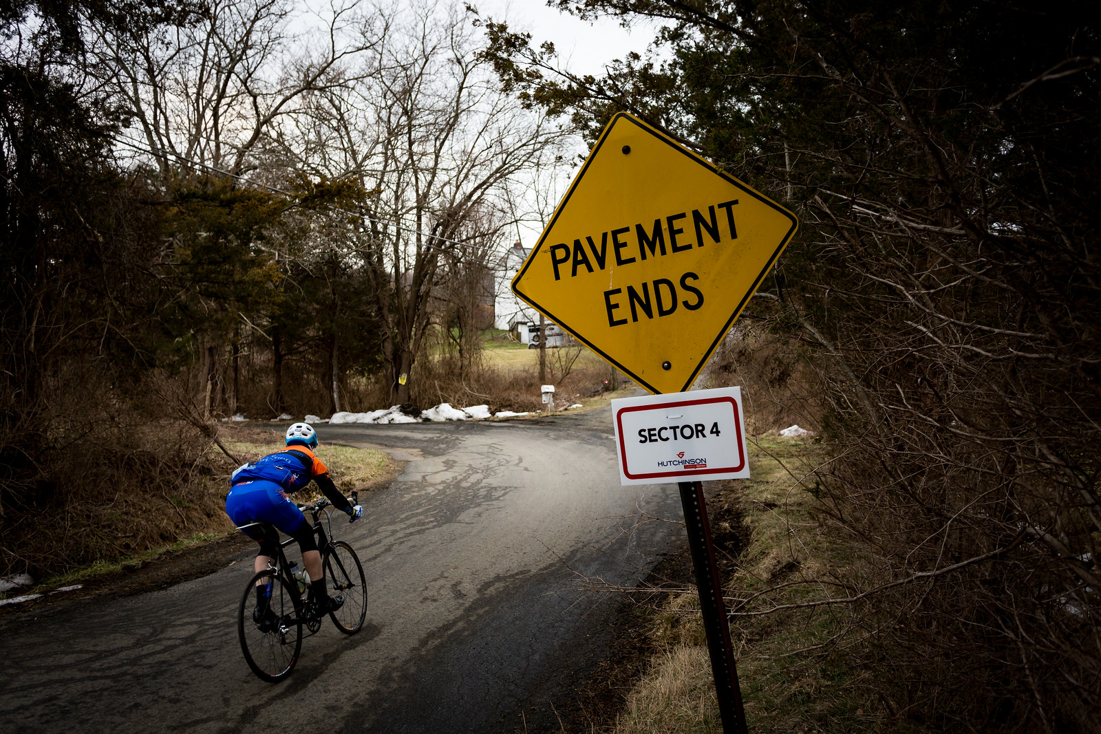 Hutchinson Tires  again sponsored the unpaved sectors by counting down the progress. Each section started with a sign like this and finished with a satisfying slash, much like the Paris-Roubaix. Here a rider navigates a sharp turn on Hunter Road where it becomes gravel.Photo courtesty Mike Maney.