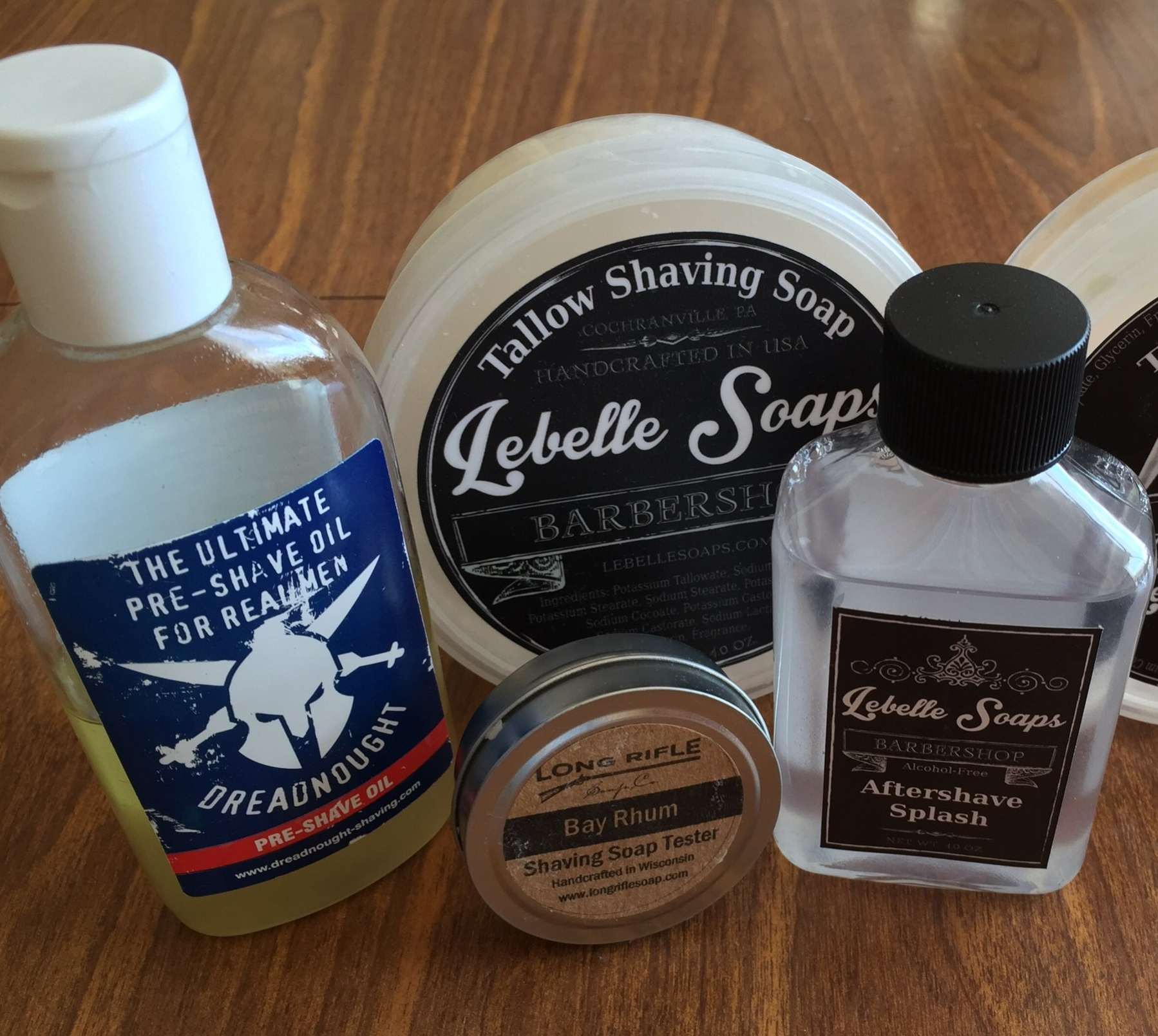 Featured from left to right: Dreadnought pre-shave oil, Lebelle Soaps Barbershop shave soap, Long Rifle Soap Company Bay Rhum tester, and Lebelle Soaps Barbershop Aftershave Splash. The tester is a good indication of the typical size of a sample.