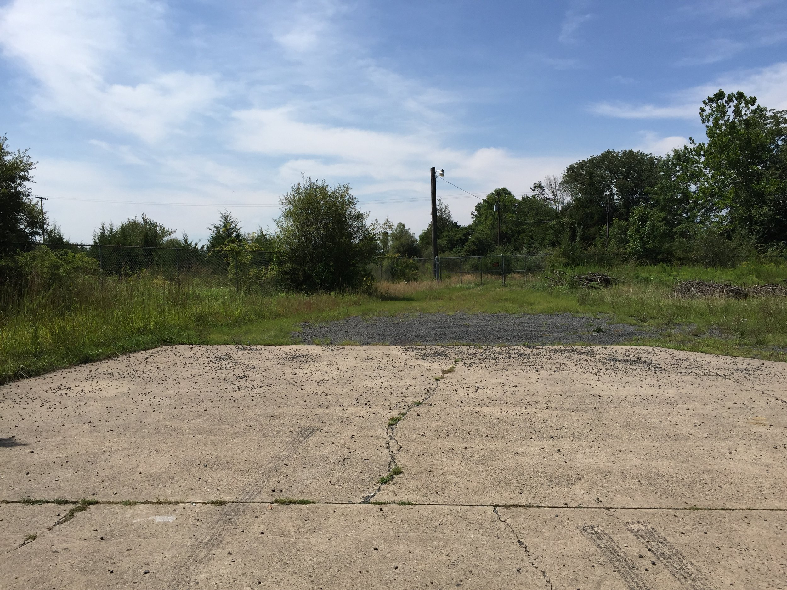 A curious driveway to nowhere. The Revere Chemical Waste Site access road from Beaver Run Road.