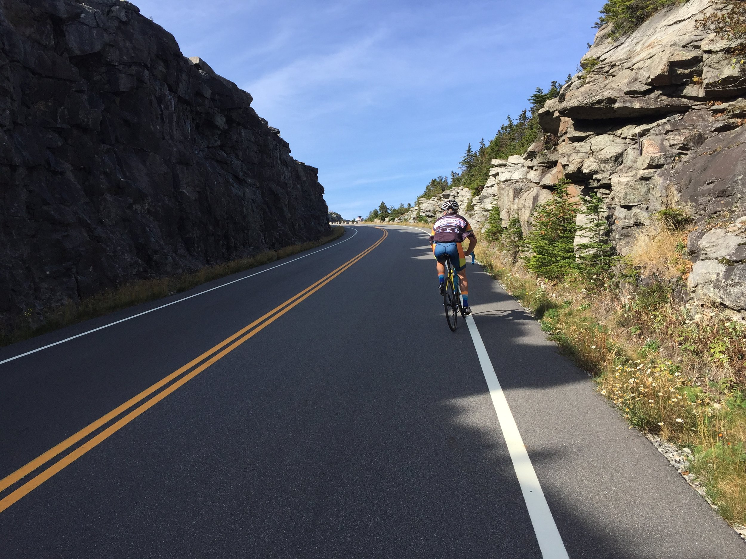 Glenn plodding through the tunnel of granite. The summit of the highway is barely visible off of the left-side wall. Here we picked up a rather favorable tailwind.