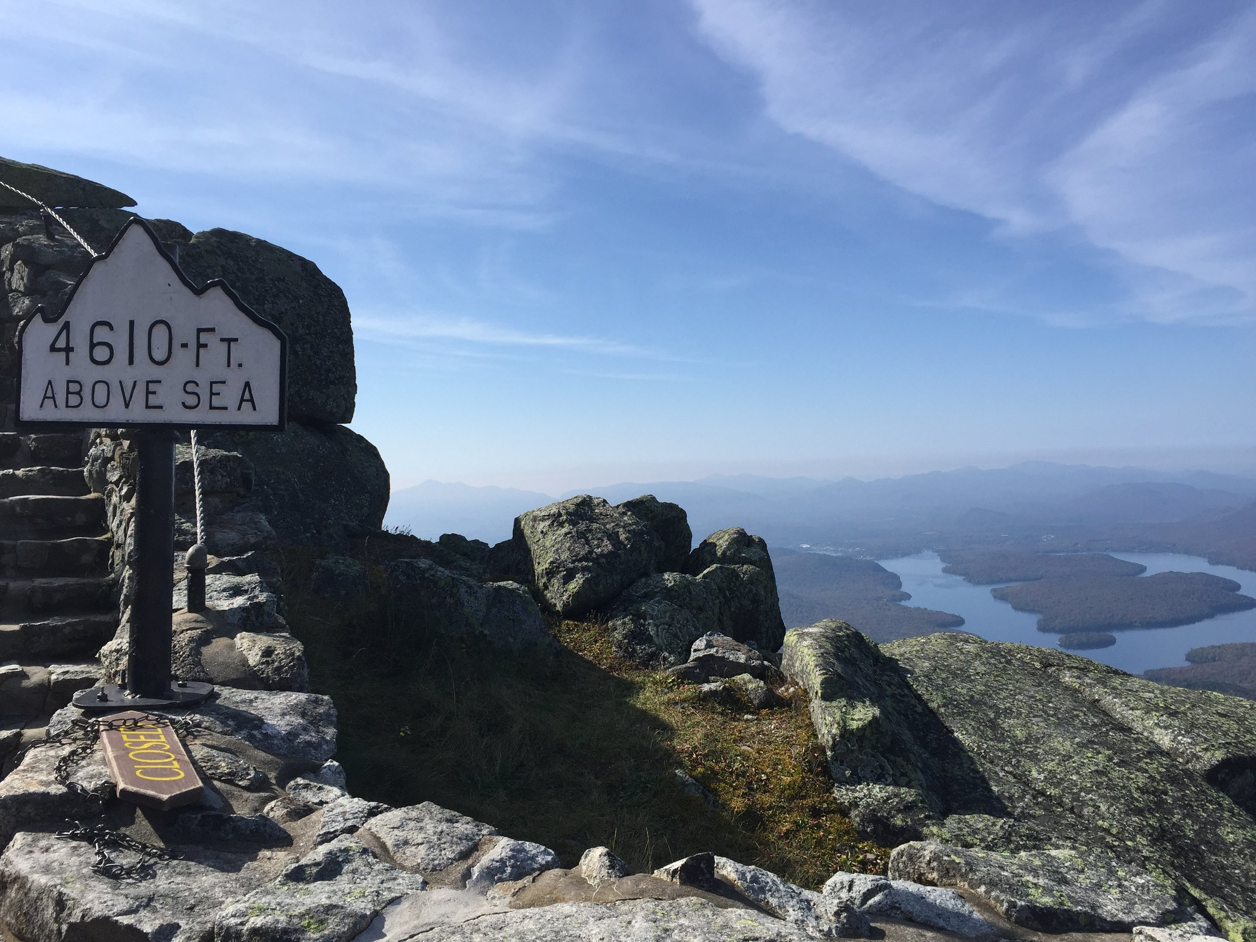 The quintessential photo taken by nearly every guy in our group: The sea level sign with Lake Placid proper in the background. The stairs led to the Summit Cafe.