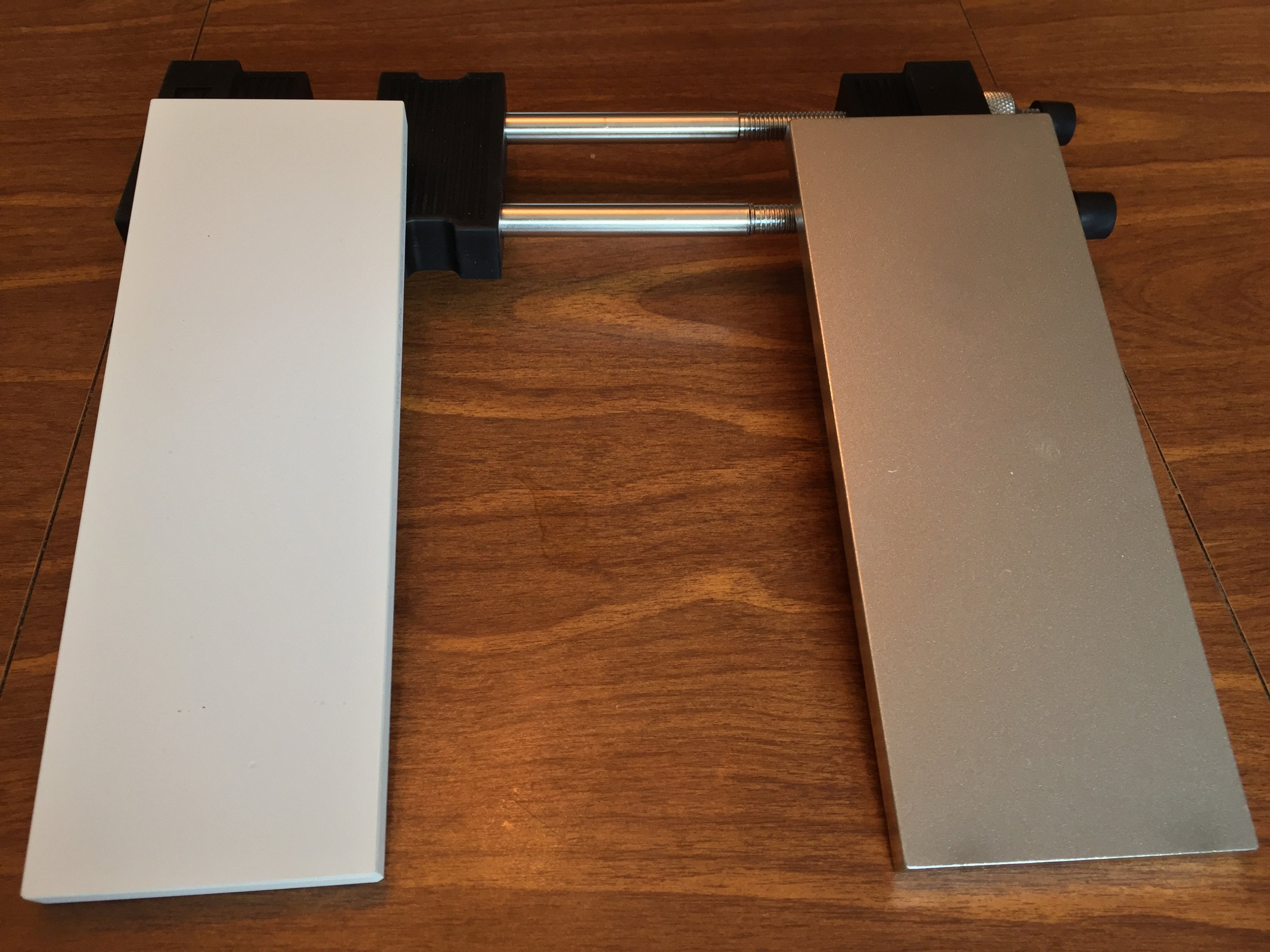 From left to right: The Naniwa 12k grit sharpening stone, the Naniwa Sharpening Stone Holder, the DMT D8C 325 Diamond Lapping plate.