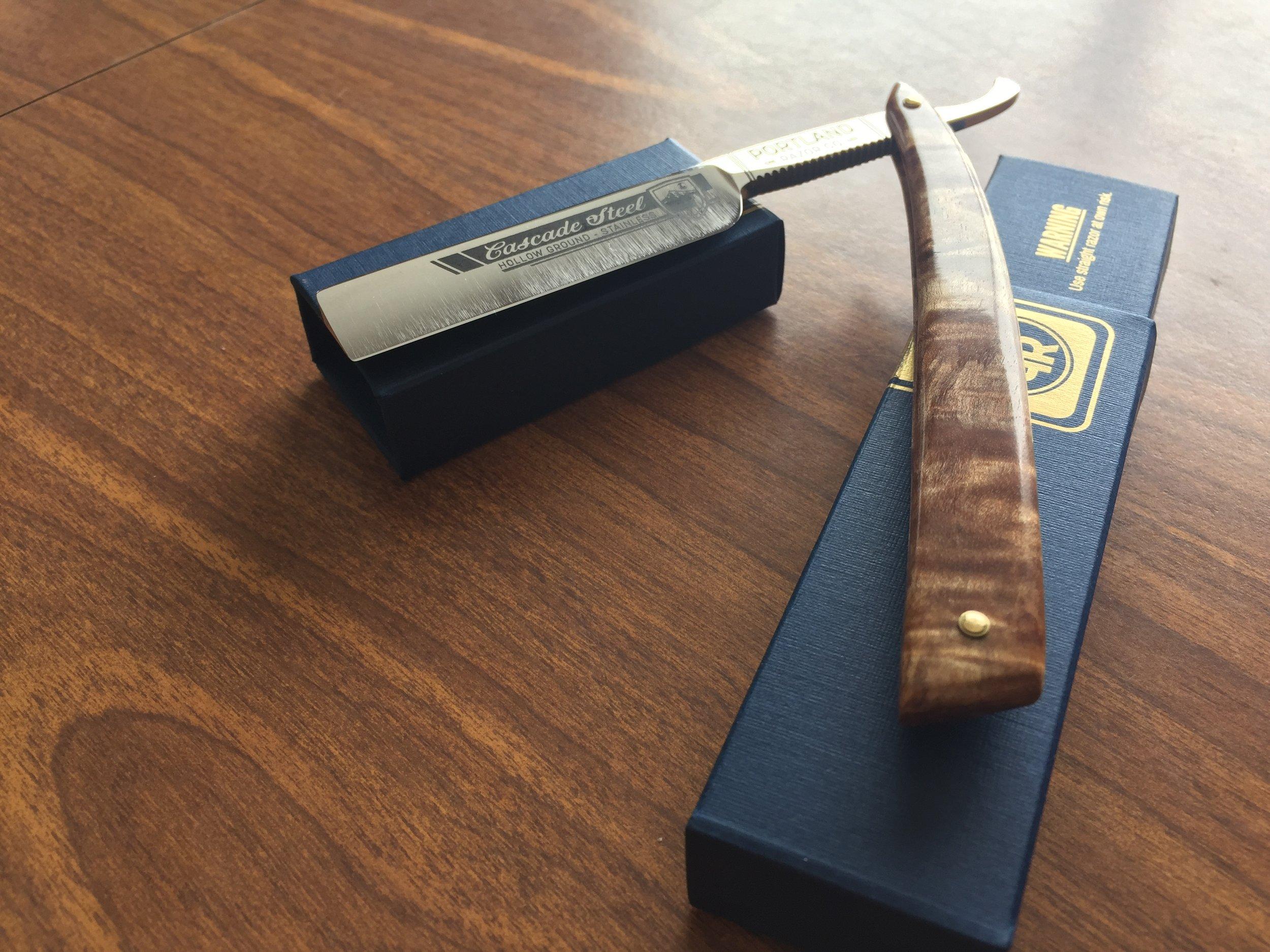 Detail of the box and Cascade Steel near-wedge razor by Portland Razor Company.