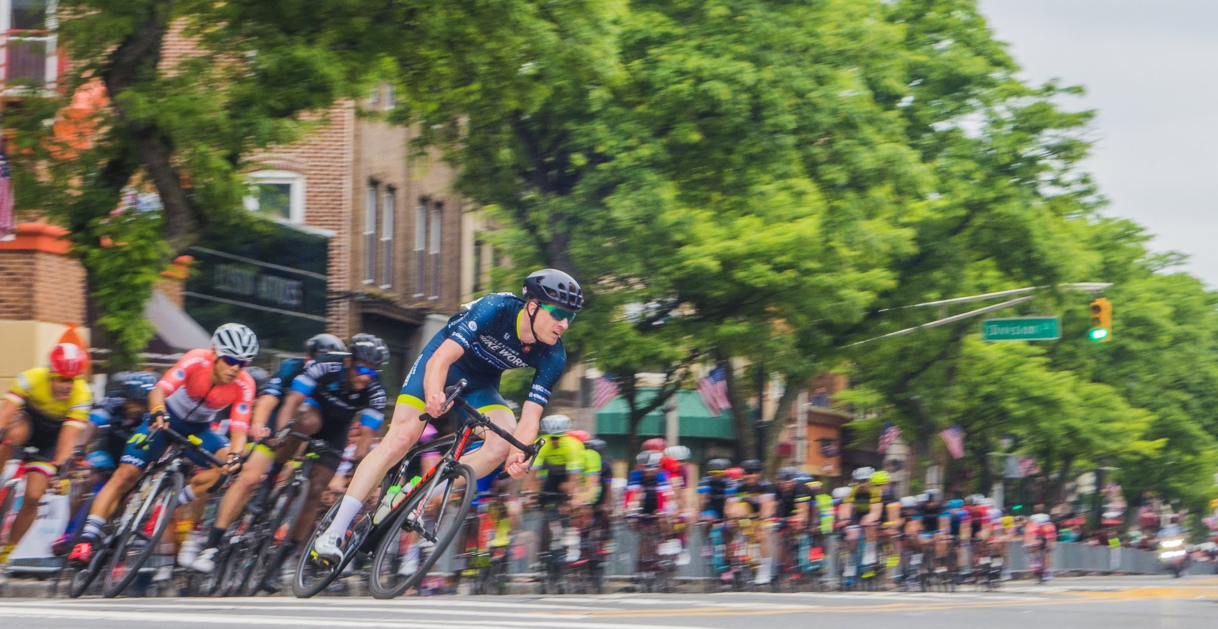 Jason Wood of Doylestown Bike Works leads the Pro/ 1 group into the first turn of the Tour of Somerville. Photo by Ron Short