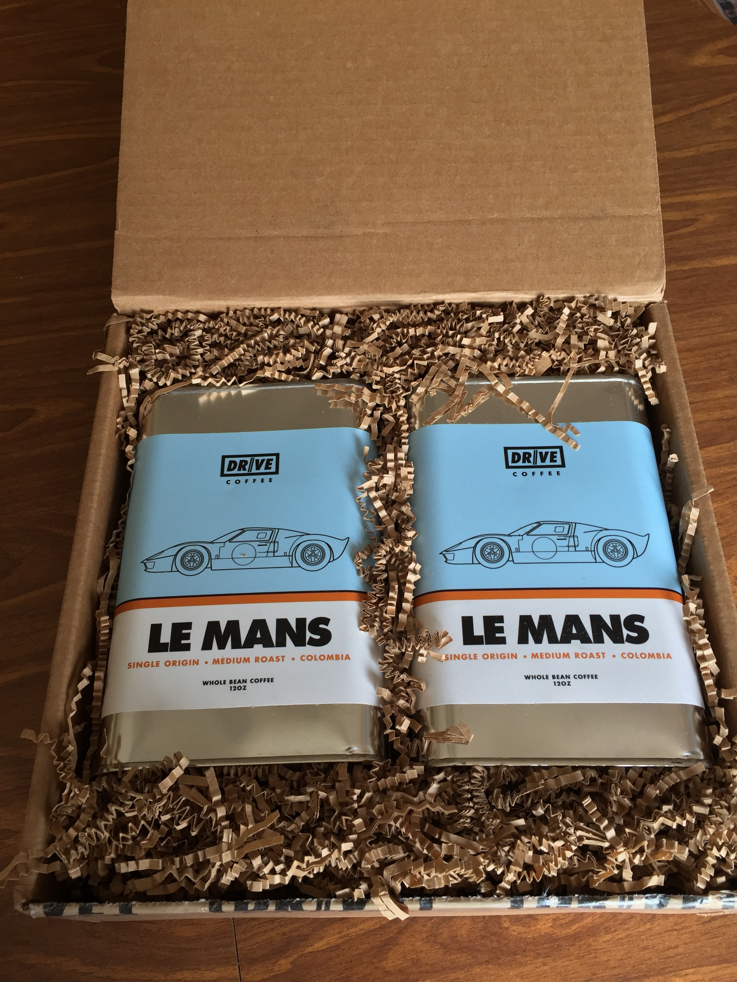 Two oilcans of Drive Coffee's Le Mans single origin medium roast.
