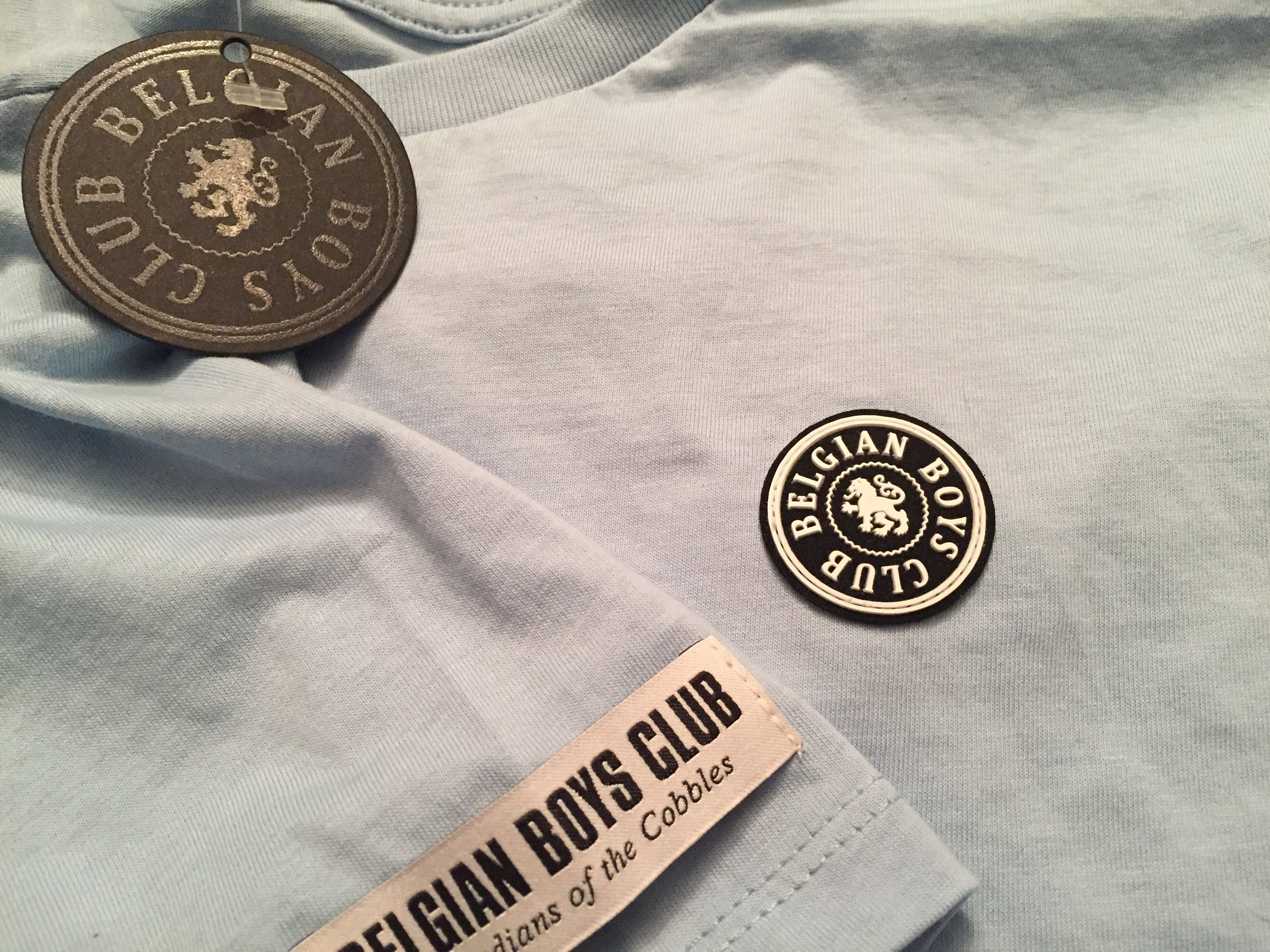 Belgian Crew goes the extra length to sew labels onto their crew shirt.