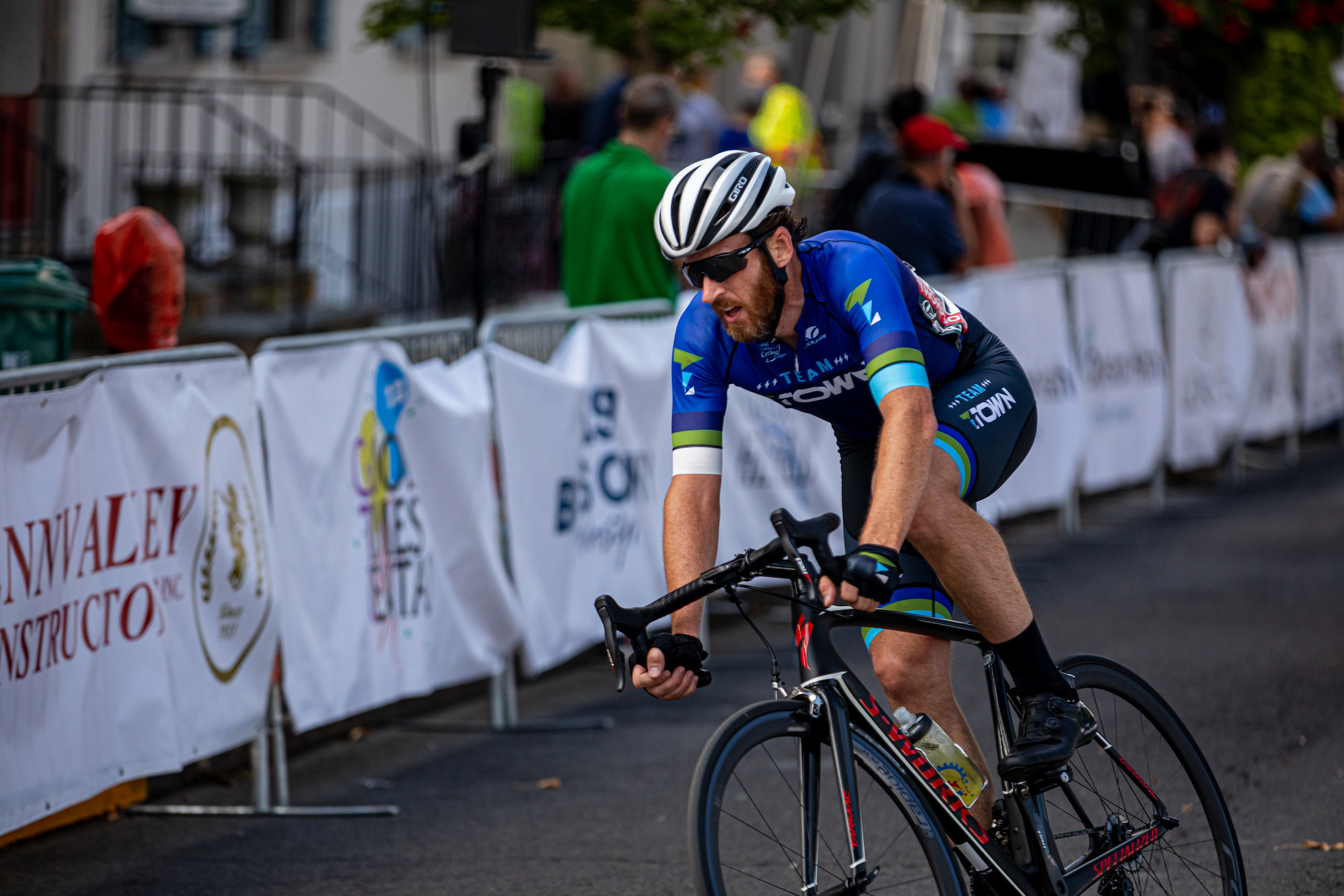 Brian Hitchon of Team T'Town goes into the first turn of the men's Cat 4/5 race. Photo courtesy   Mike Maney  .