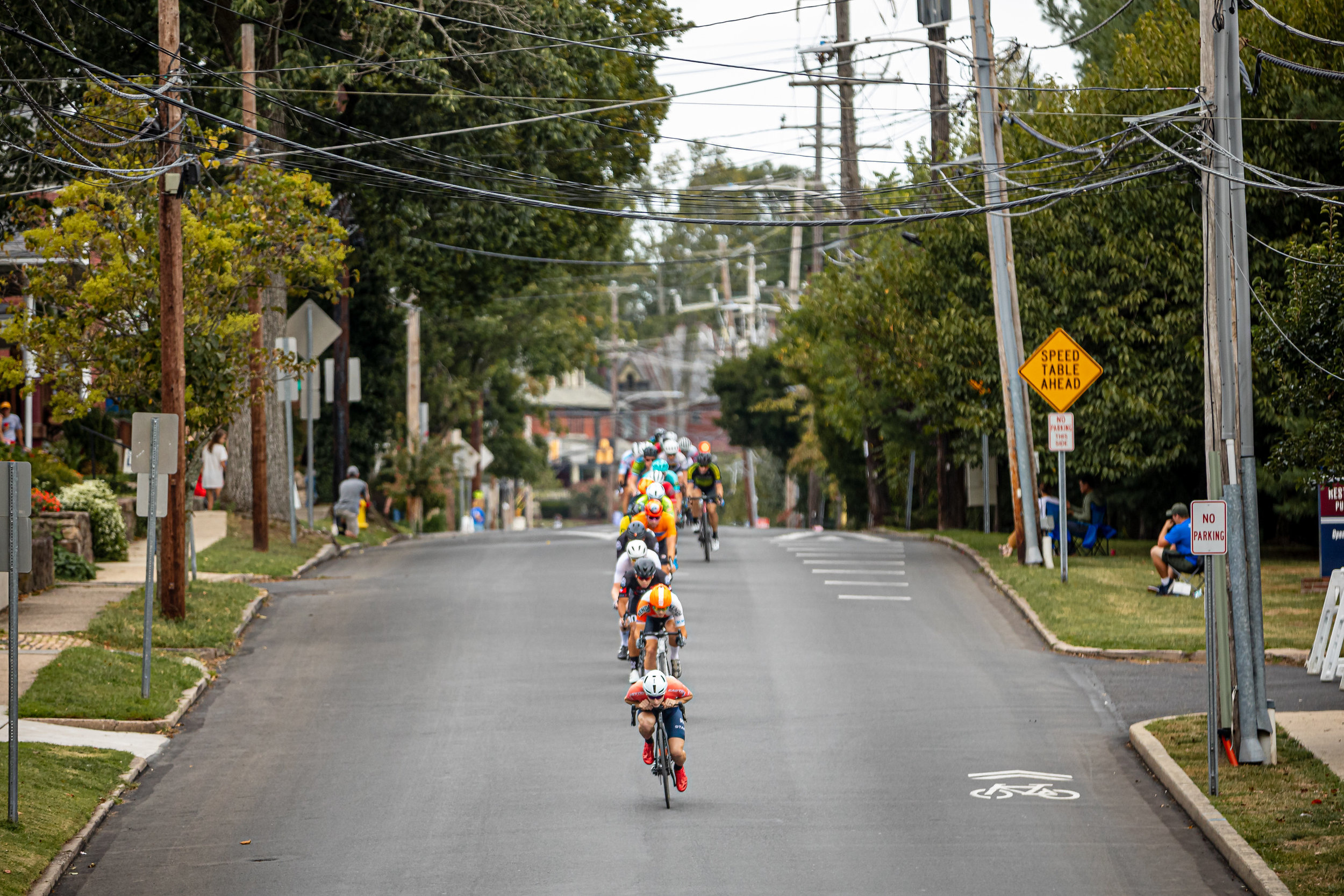 With eighteen laps remaining, the breakaway snapped from the peloton and stayed away, captured here by Mike Maney's photo at the end of Ashland Street. Photo courtesy   Mike Maney  .