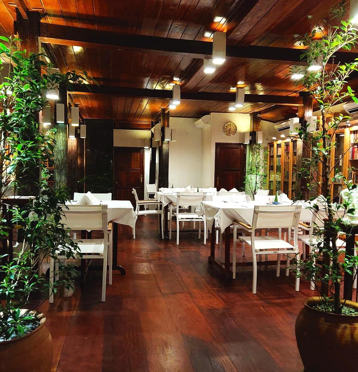 Blue Lagoon has beautiful dark wood flooring and elegant white dining tables