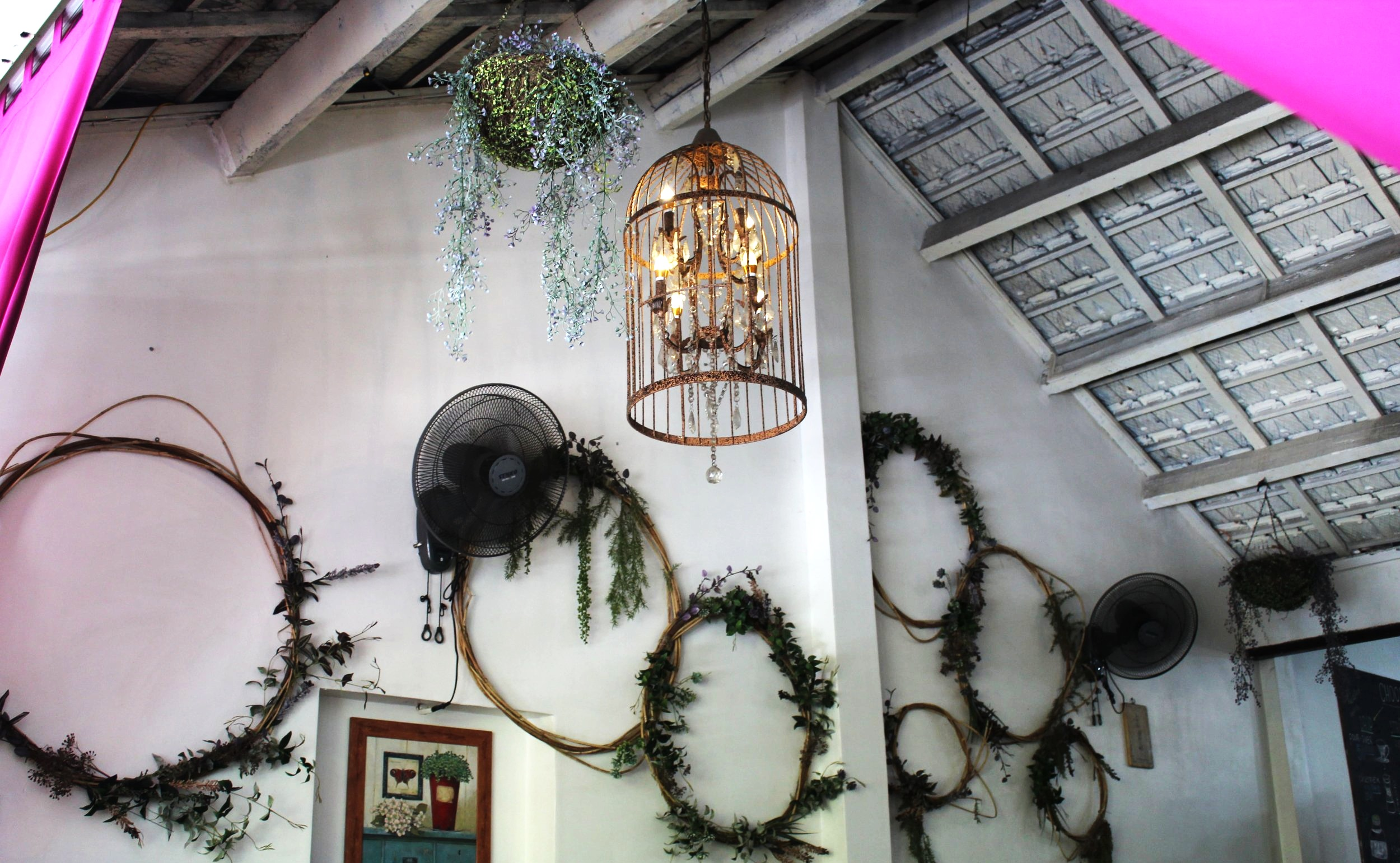 Quirky gold-painted birdcage light fixtures hang from the ceilings