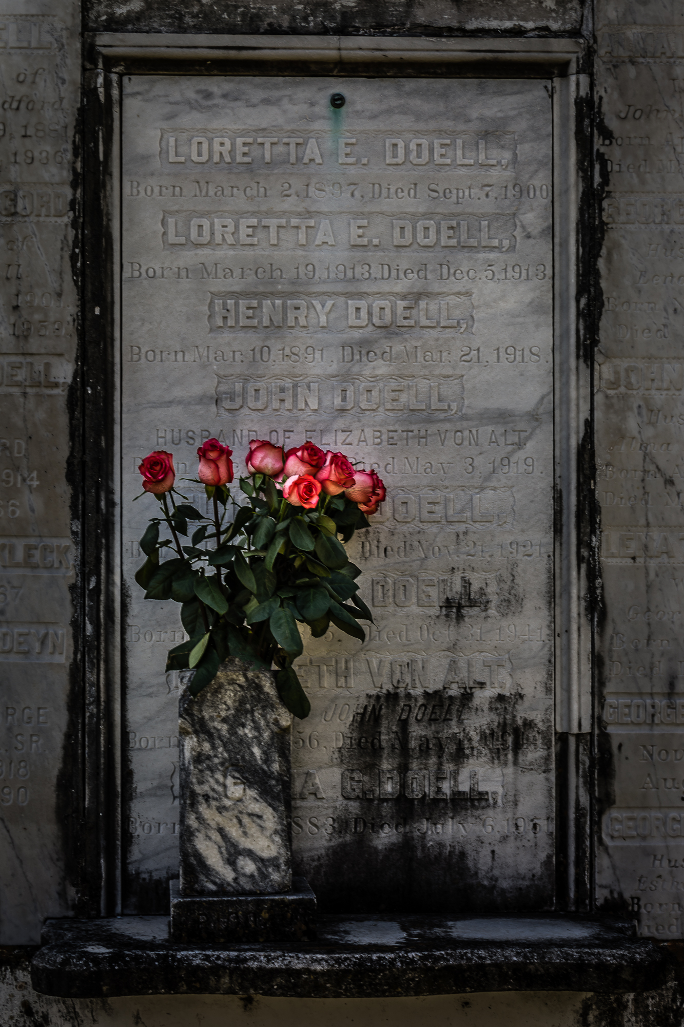 Cloth flowers on a tomb in Lafayette Cemetery, New Orleans