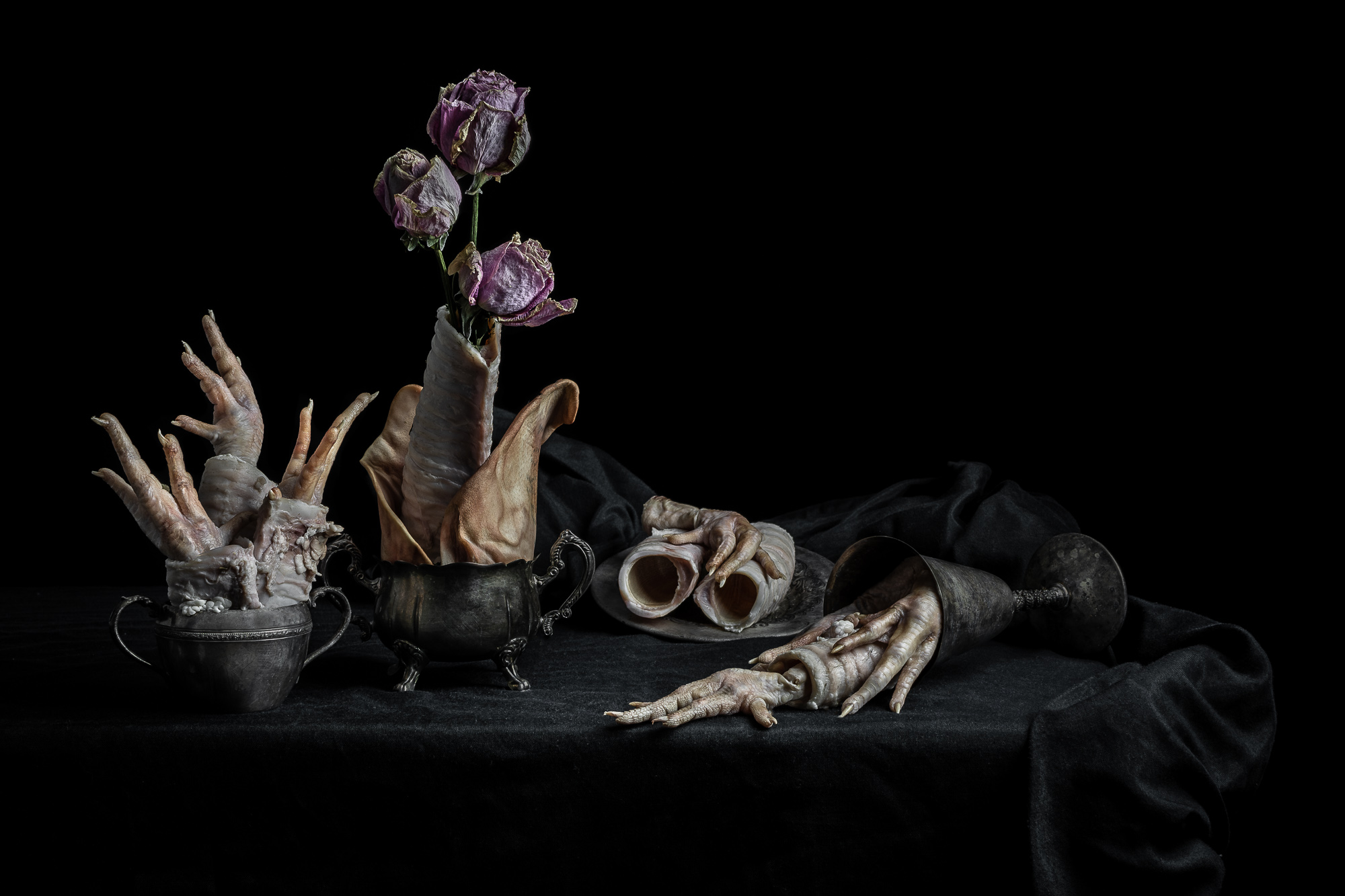 Floral Arrangement with Chicken Feet, Cow Trachea, and Pig Ears