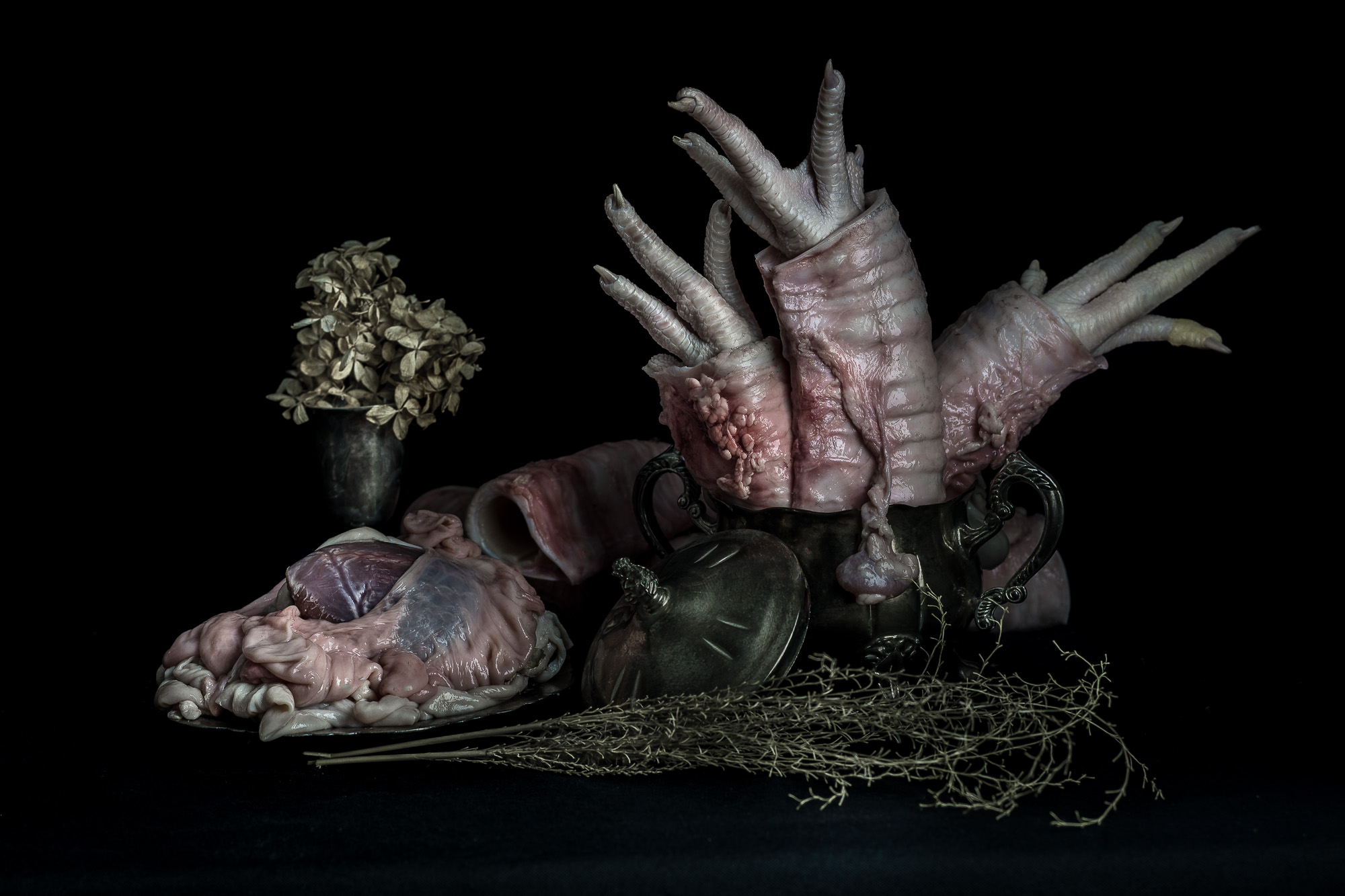 Floral Arrangment with Chicken Feet, Cow Trachea, and Pig Intestines
