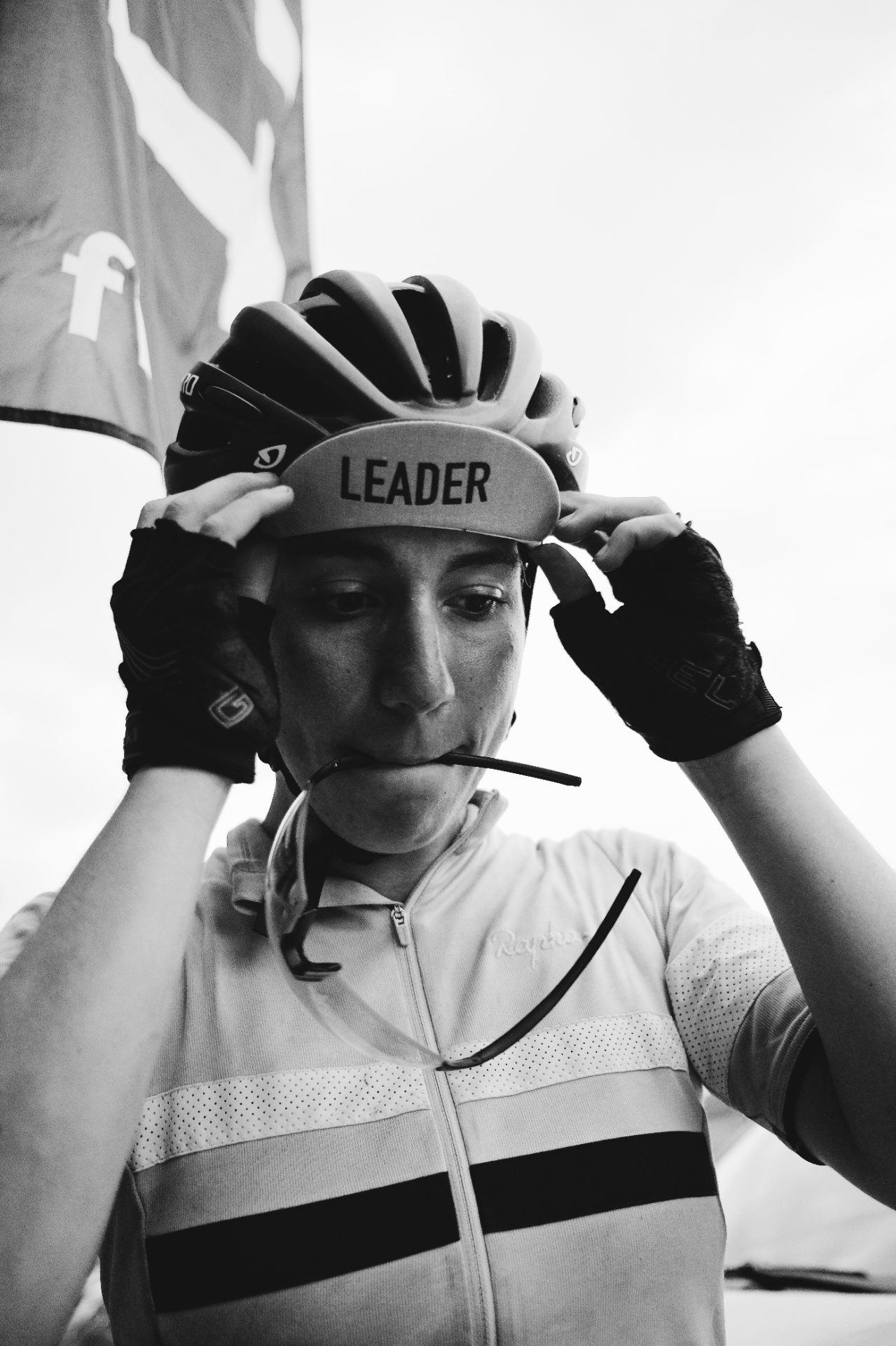 Fiona Kolbinger pulls on the women's leader cap.