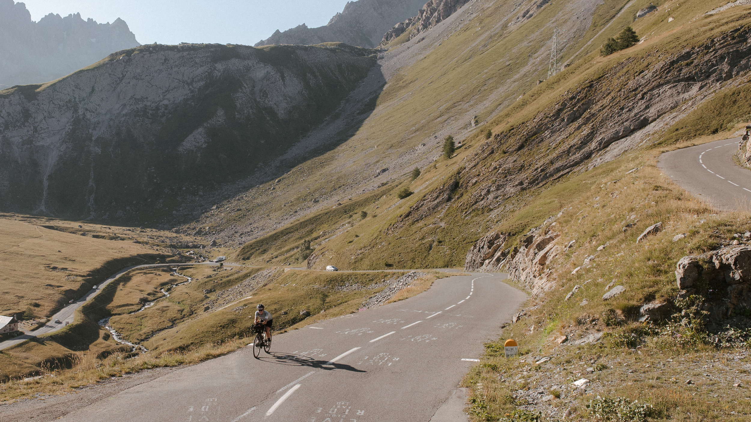 Fiona cruises along roads painted with names of Tour de France riders. Photo: Angus Sung©