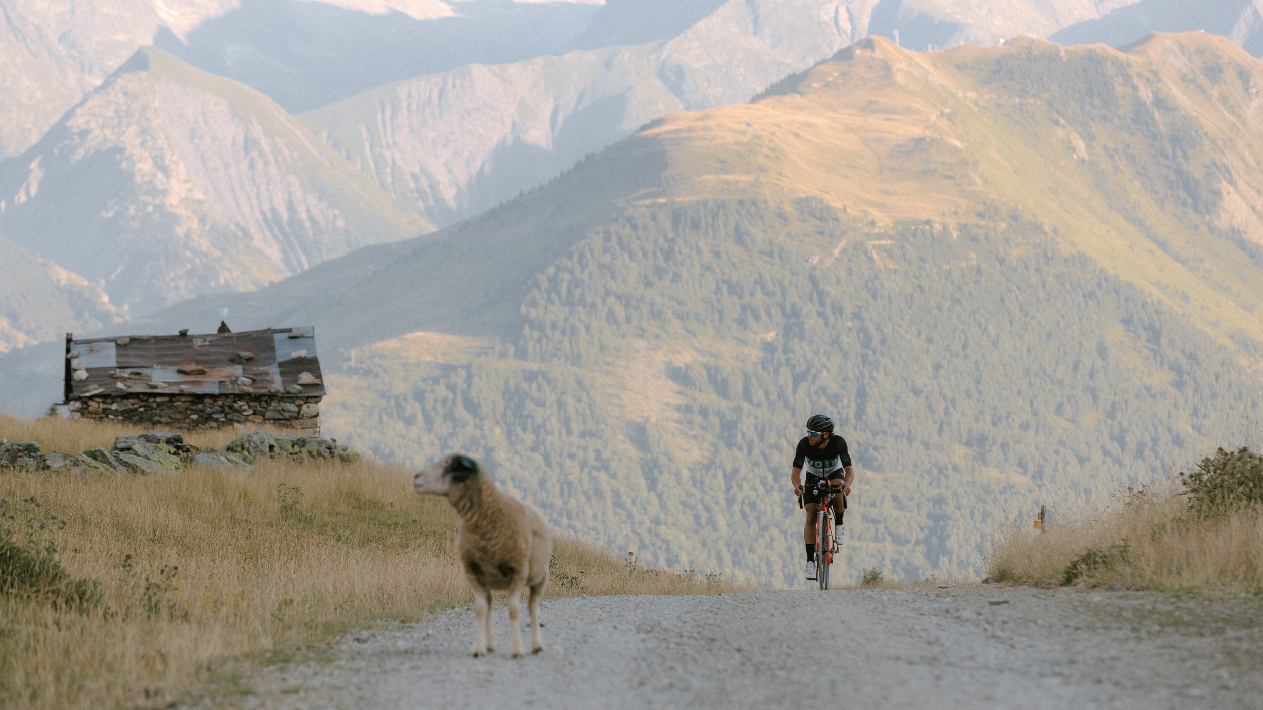 Ben Davies on the gravel roads of Route du Col de Sarenne towards Alpe d'Huez. Photo: Angus Sung©