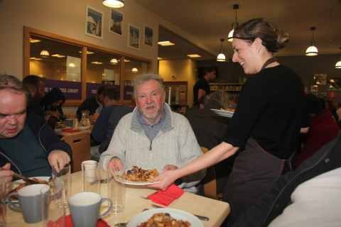Happy diners at a FoodCycle Portsmouth meal held at John Pounds Centre