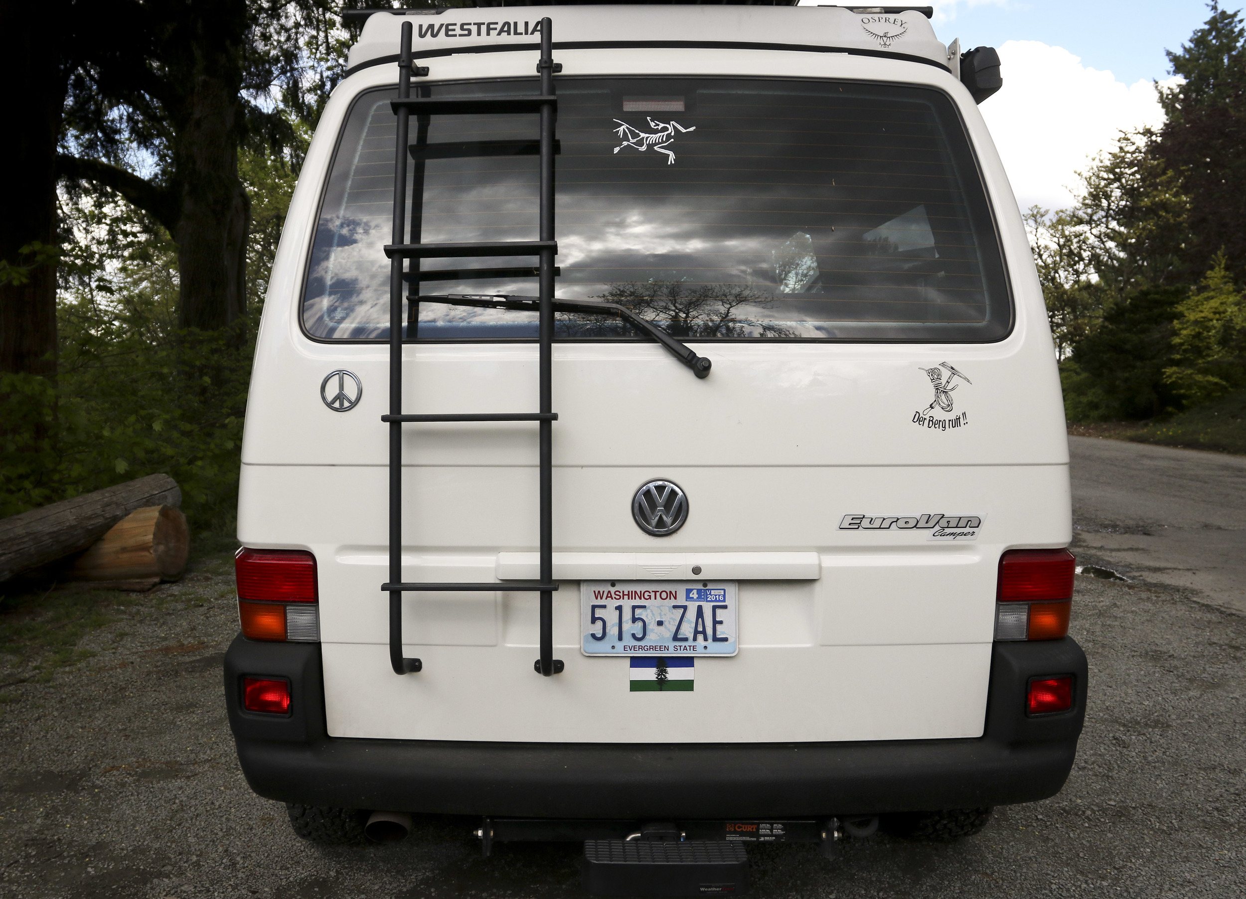 The custom ladder was made locally in Leavenworth, WA allowing easy access to the roof.    The trailer hitch features a step that is useful for climbing the ladder or closing the hatch back.