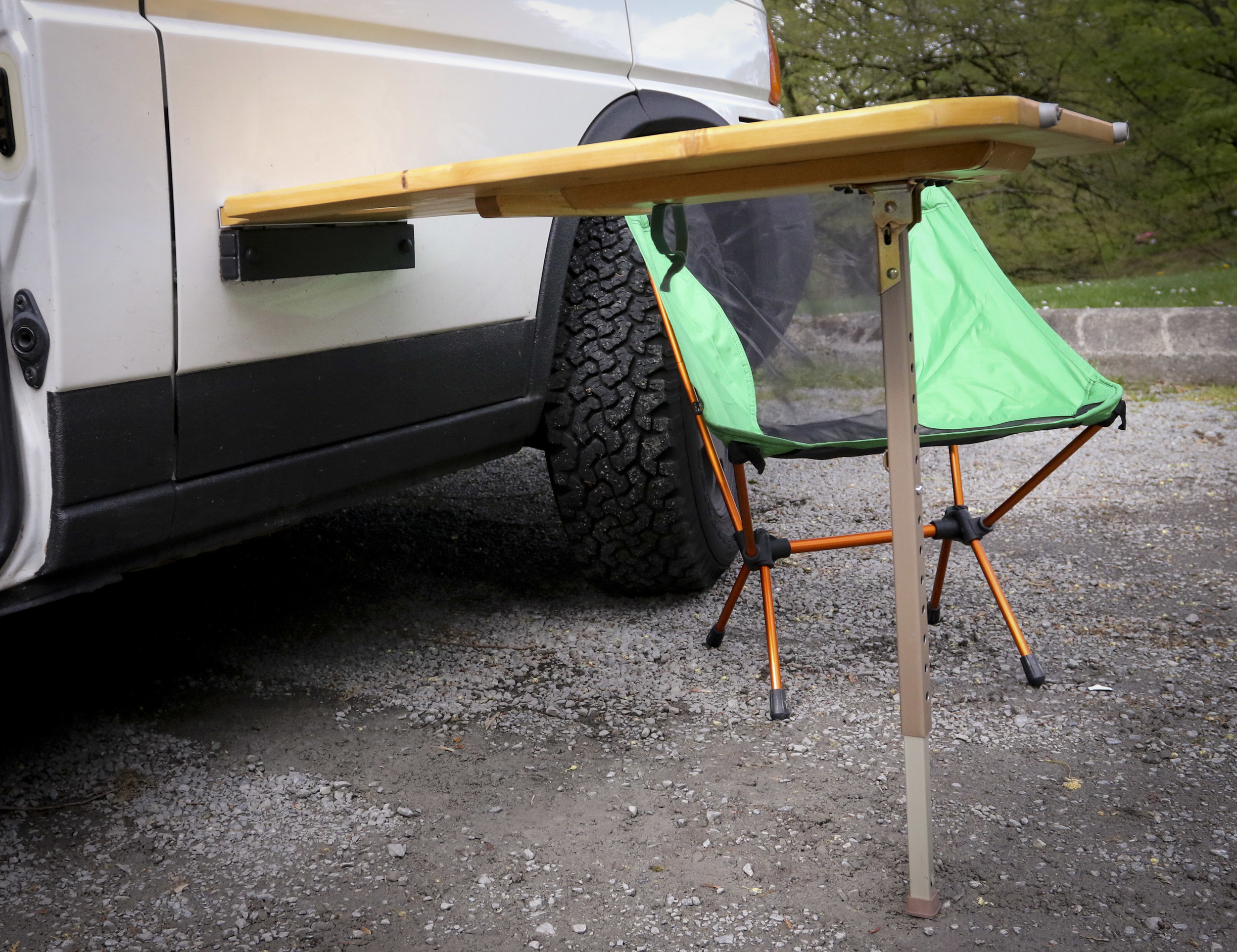 Exterior Mounted Pine Table  The table is held up by an adjustable folding leg made by Heaffle.