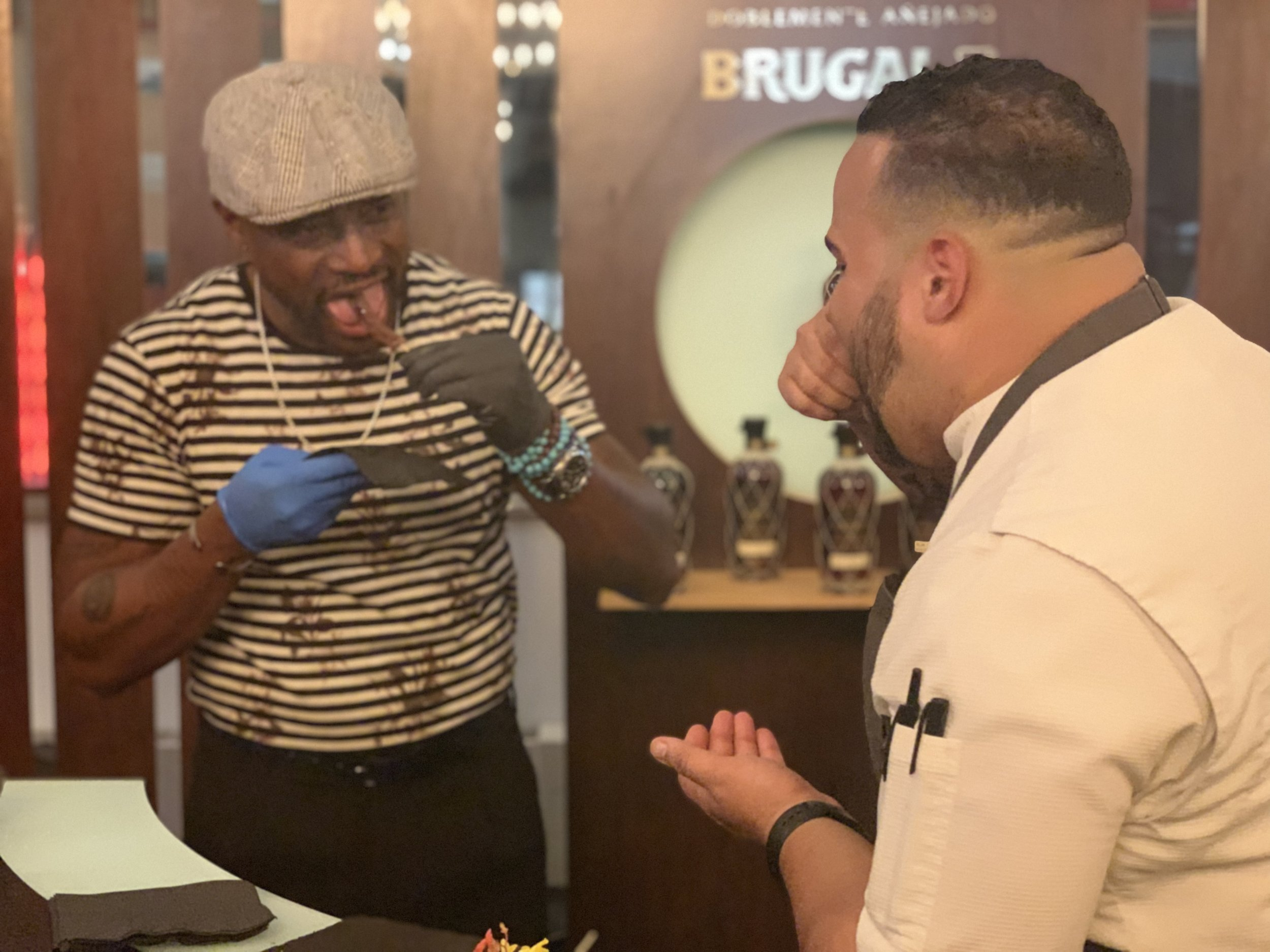 Actor Taye Digg (left) and Chef Kelvin Tasting the Roasted Beef