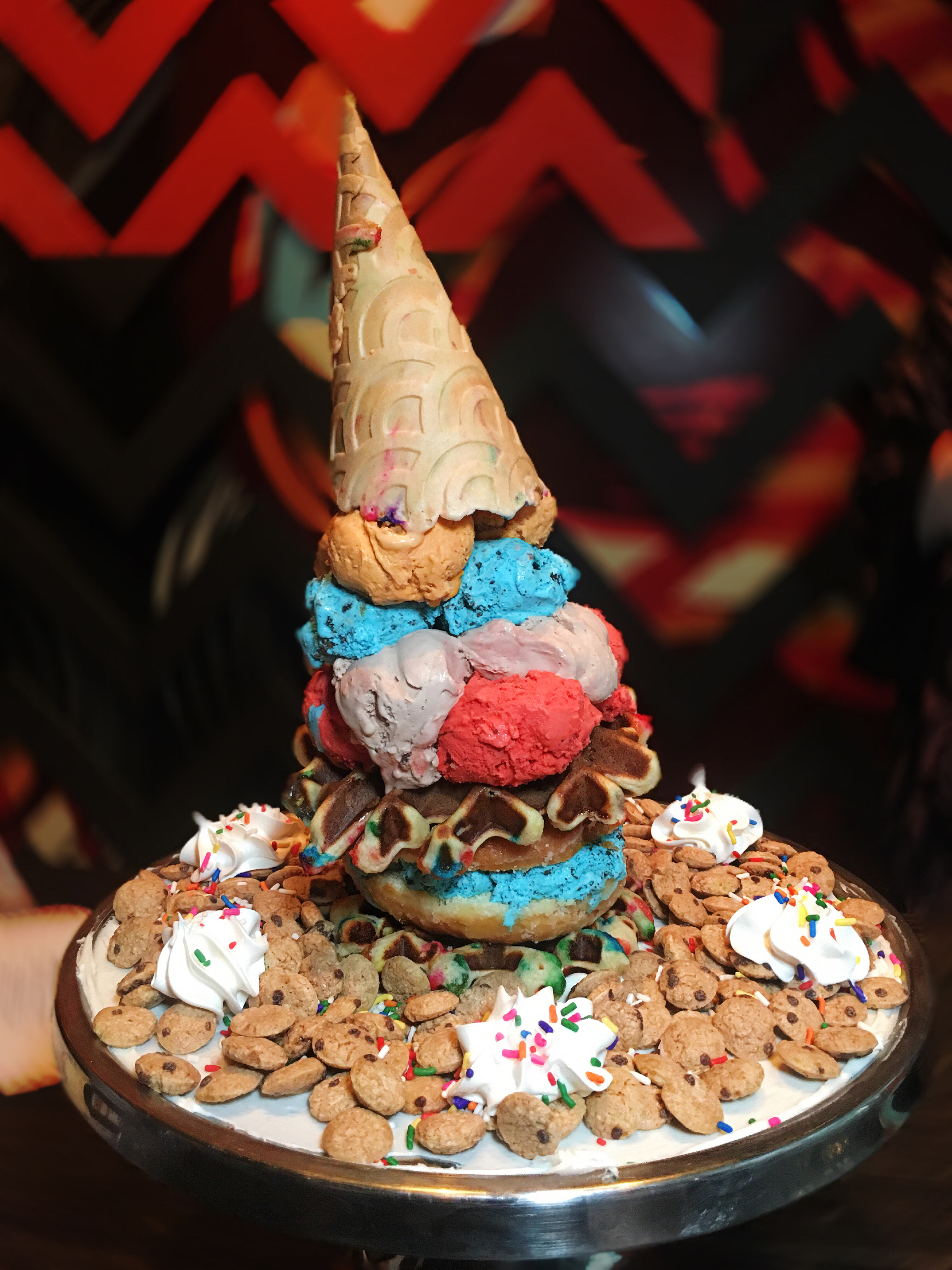- Starting from the bottom, we have Stuffed Ice Cream's cookie monster cruff sandwiched between two of Clinton Hall's birthday cake waffles, then stacked with scoops of Red Velvet, Ferrero Rocher, Cookie Monster, and Snickerdoodle ice cream, and finally topped with a birthday sugar cone. If that wasn't enough sugar, the whole platter is decorated with frosting, sprinkles, whipped cream, and cookie crisp cereal.