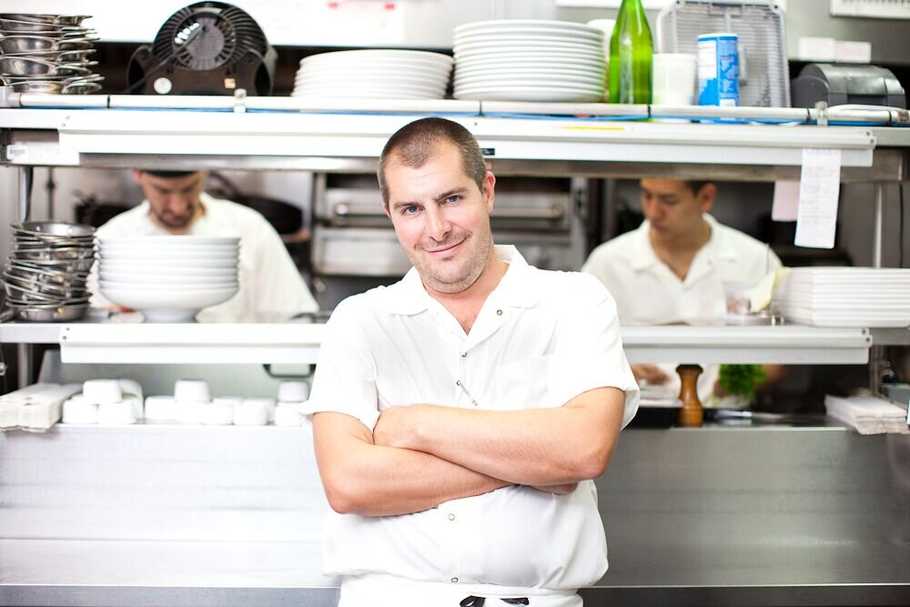 Top Chef  winner and consulting chef Harold Dieterle at the helm in the kitchen. Photo Credit - Oleg March