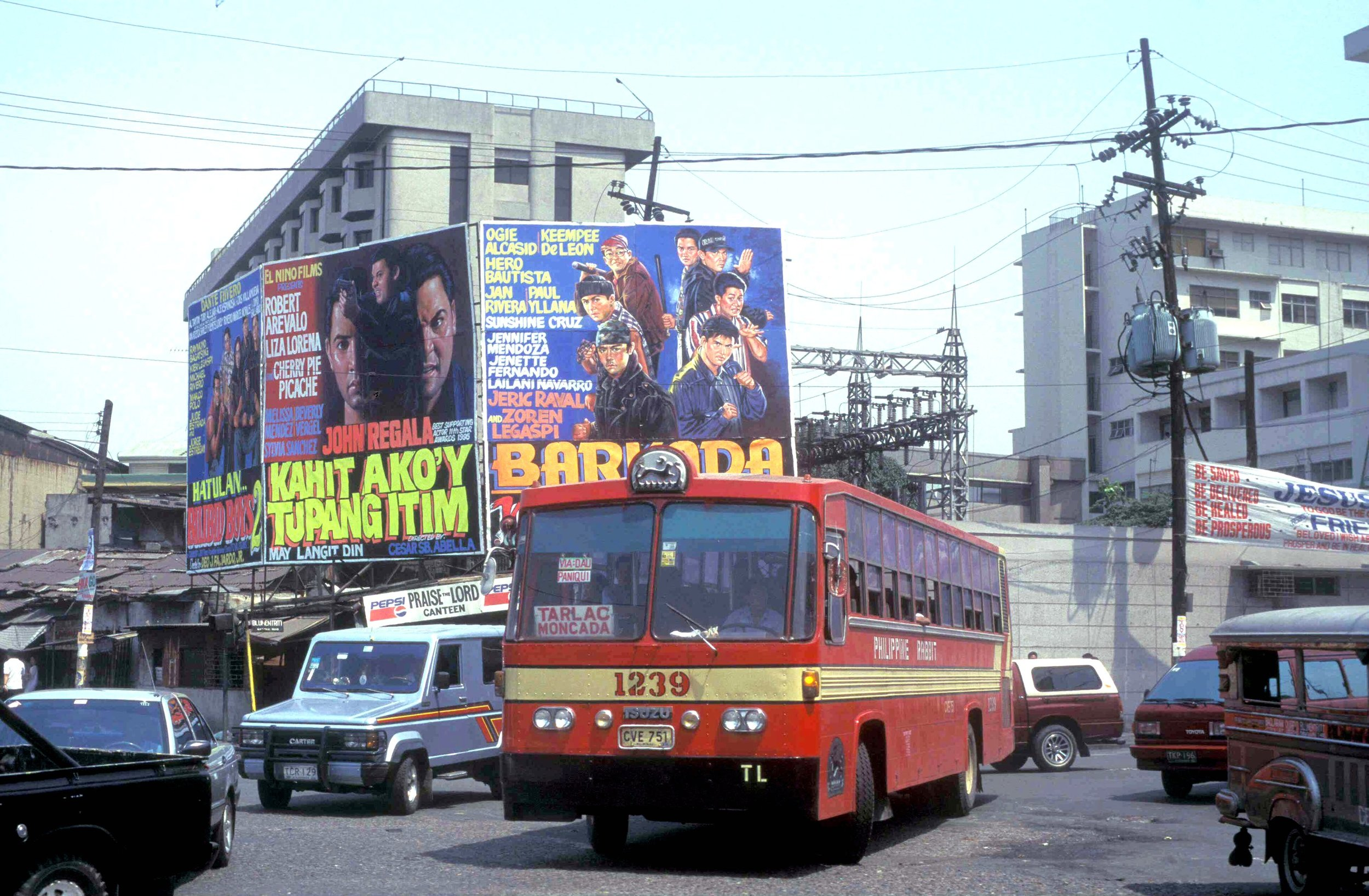 FIgure 5:Hand-painted movie posters for local commercial films, 1995. These were low-budget, quickly produced films made by outfits like El Nino films, known as local softcore studio.Source:  John_Ward-Philippine Rabbit Isuzu CVE-751 (fleet No 1239) A Bonifacio St, Santa Cruz, Manila, Philippines-1995.