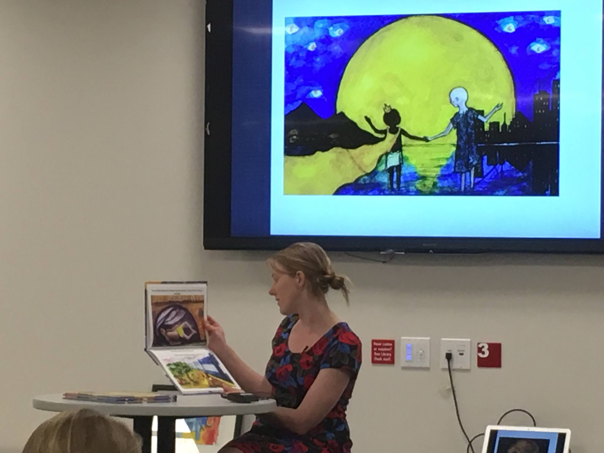 Author Daniela Anderson reads from The Moon Prince and The Sea at its June 6 book launch in Salt Lake City, Utah.