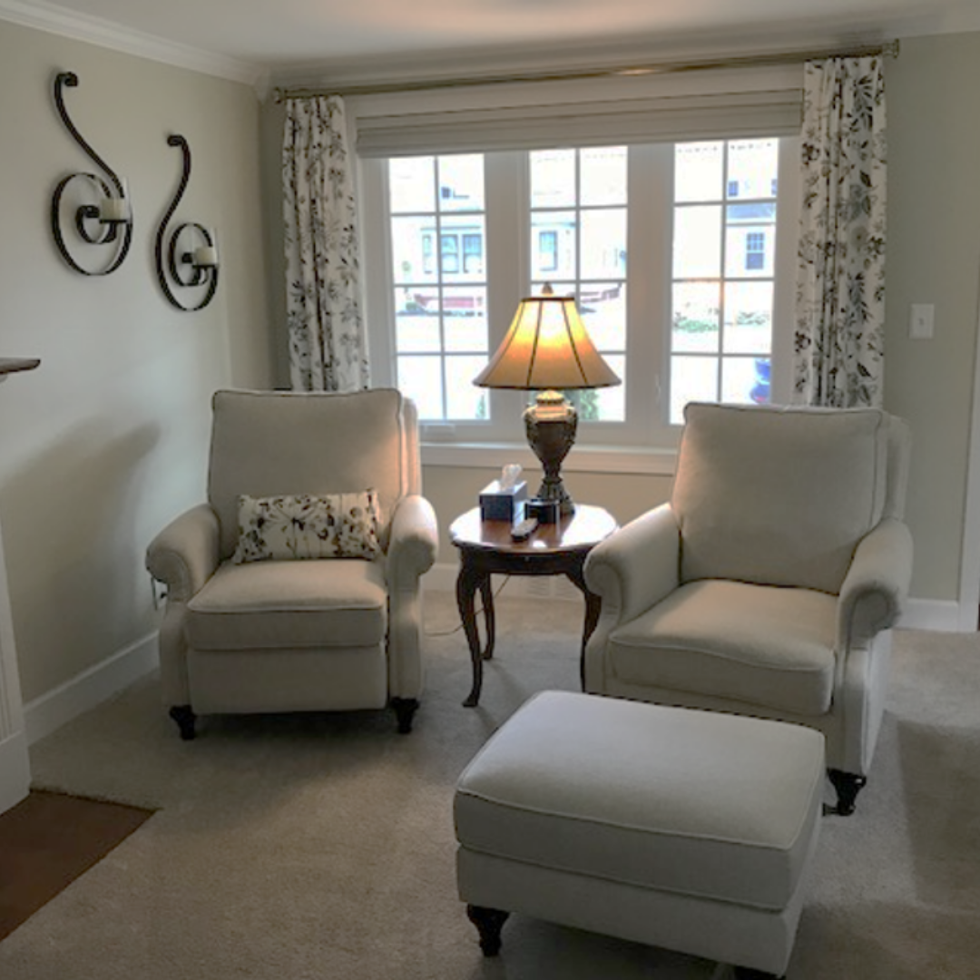 Traditional chairs in white revolution fabric custom drapes ottoman | Michael Helwig Interiors |
