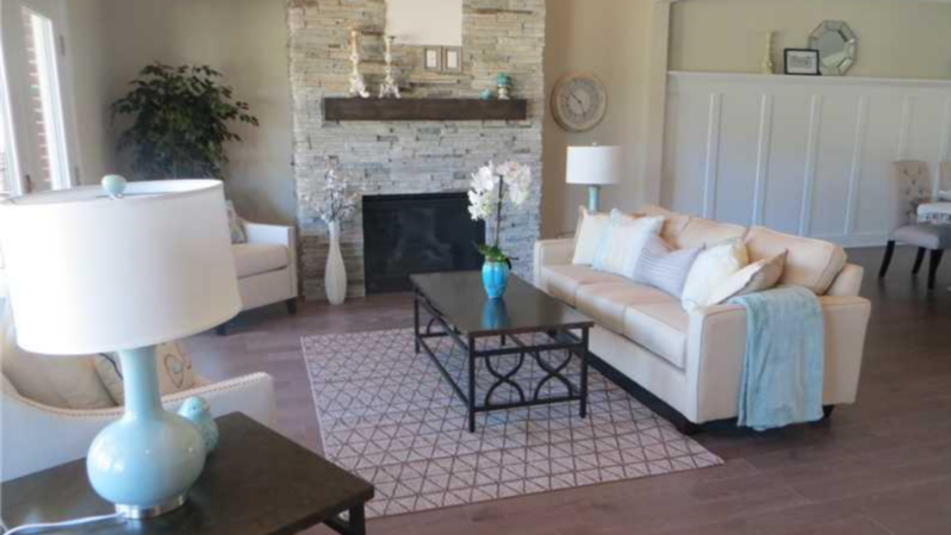 Transitional white cream leather sofa slope arm accent chairs trellis pattern area rug | Michael Helwig Interiors|