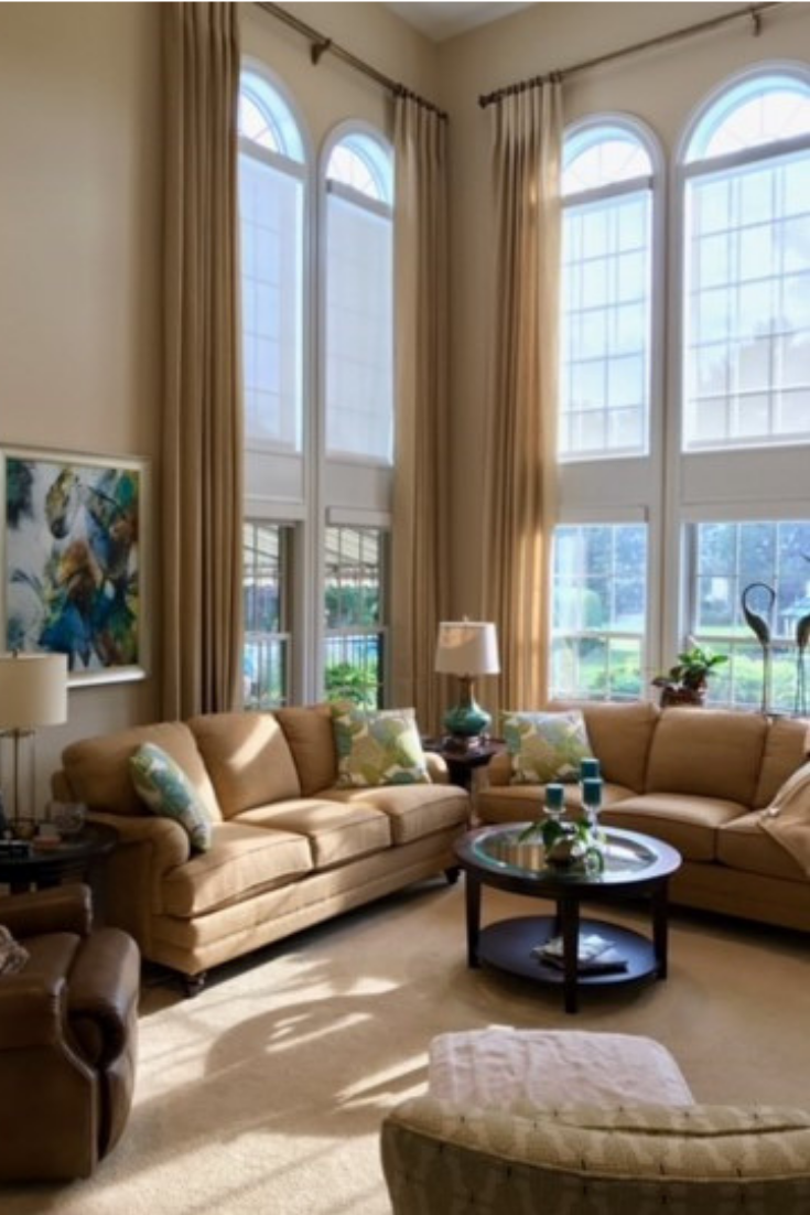 Traditional English arm sofa in beige chenille fabric with floral tall ceilings espresso craftsman style glass top table accents custom drapes | Michael Helwig Interiors |
