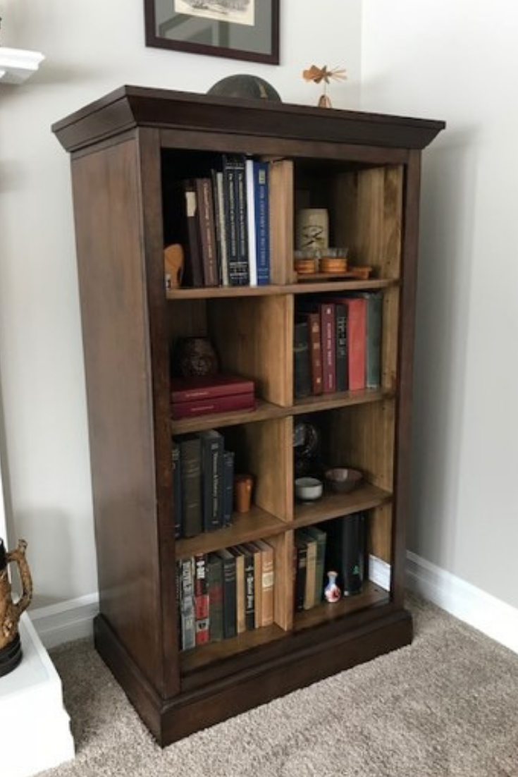 Traditional custom bookcase with walnut exterior and pine interior finish | Michael Helwig Interiors |