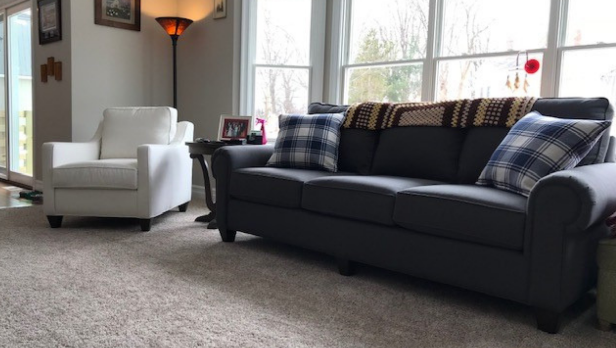 Transitional matching sofas with white custom slope arm accent chair and traditional espresso end tables Plaid modern country pillows | Michael Helwig Interiors |