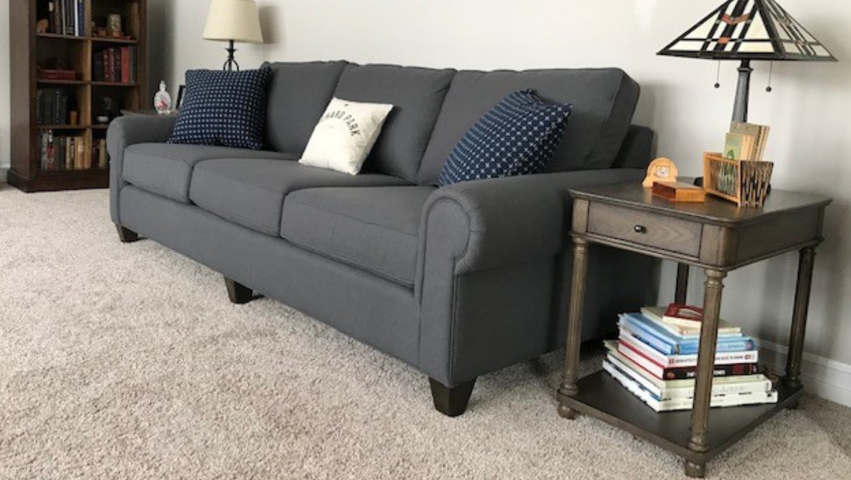 Transitional matching sofas with white custom slope arm accent chair and traditional espresso end tables geometric modern country pillows | Michael Helwig Interiors |