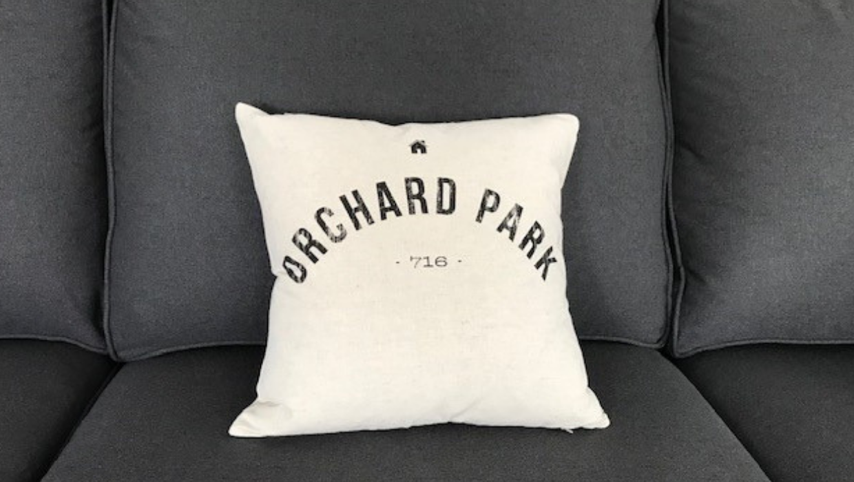 Orchard Park Pillow on gray revolution fabric sofa | Michael Helwig Interiors |