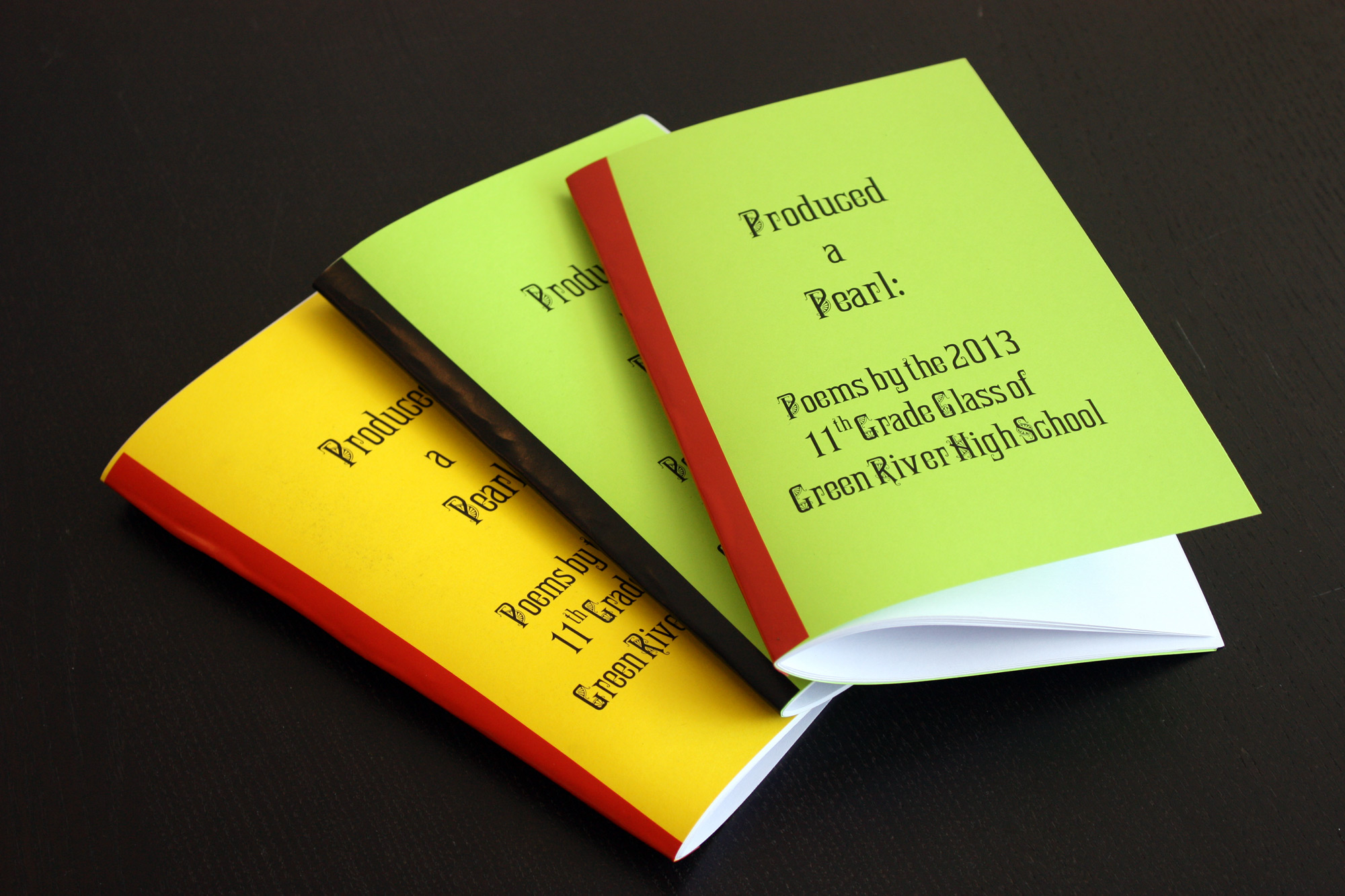 """Copies of the """"Produced A Pearl: Poems by the 2013 11th Grade Class of Green River High School"""" chapbook facilitated by Gina Abelkop"""