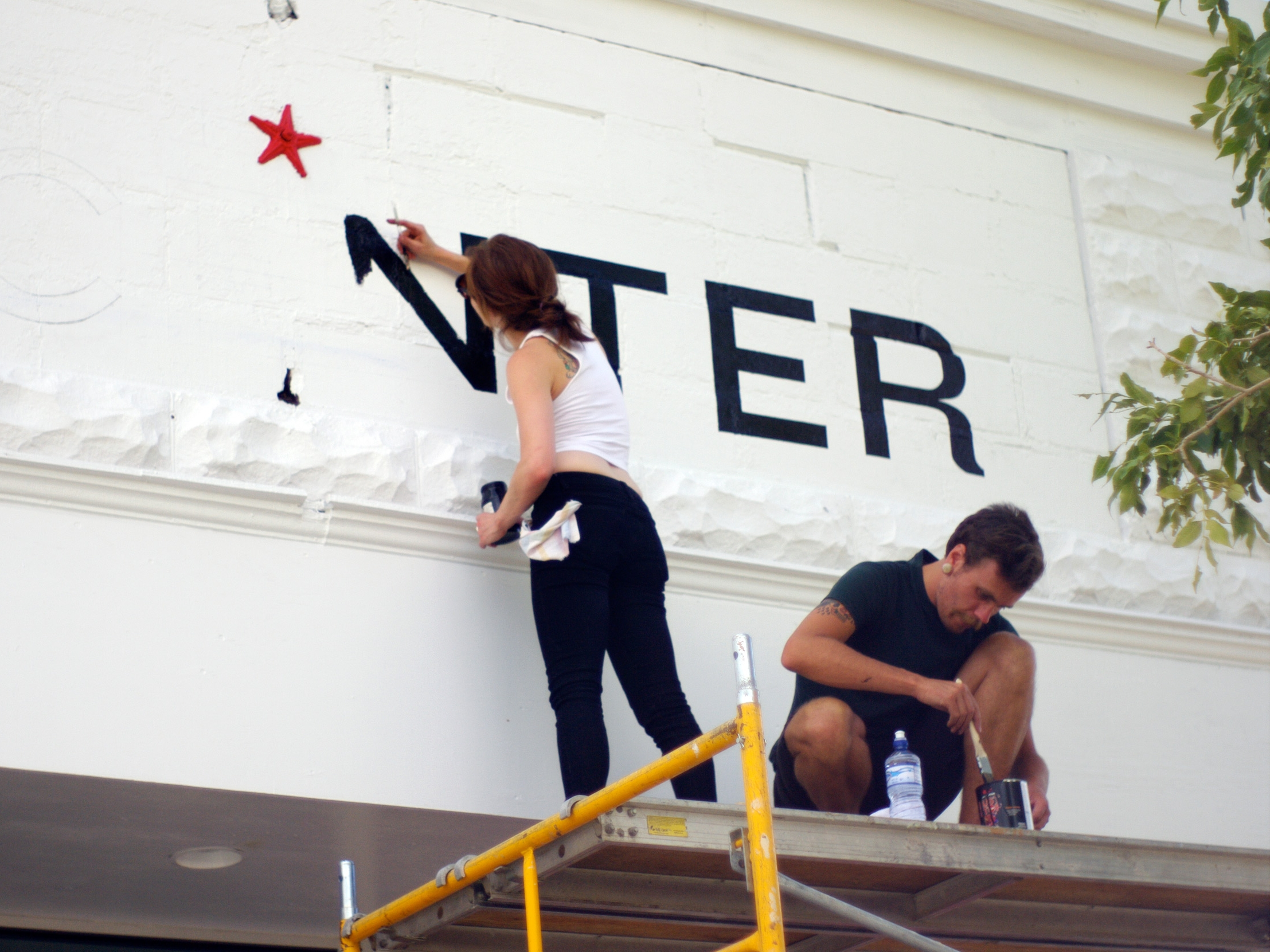 Front signage in process, 2011. Photo by Frontier Fellow Nick Zdon.