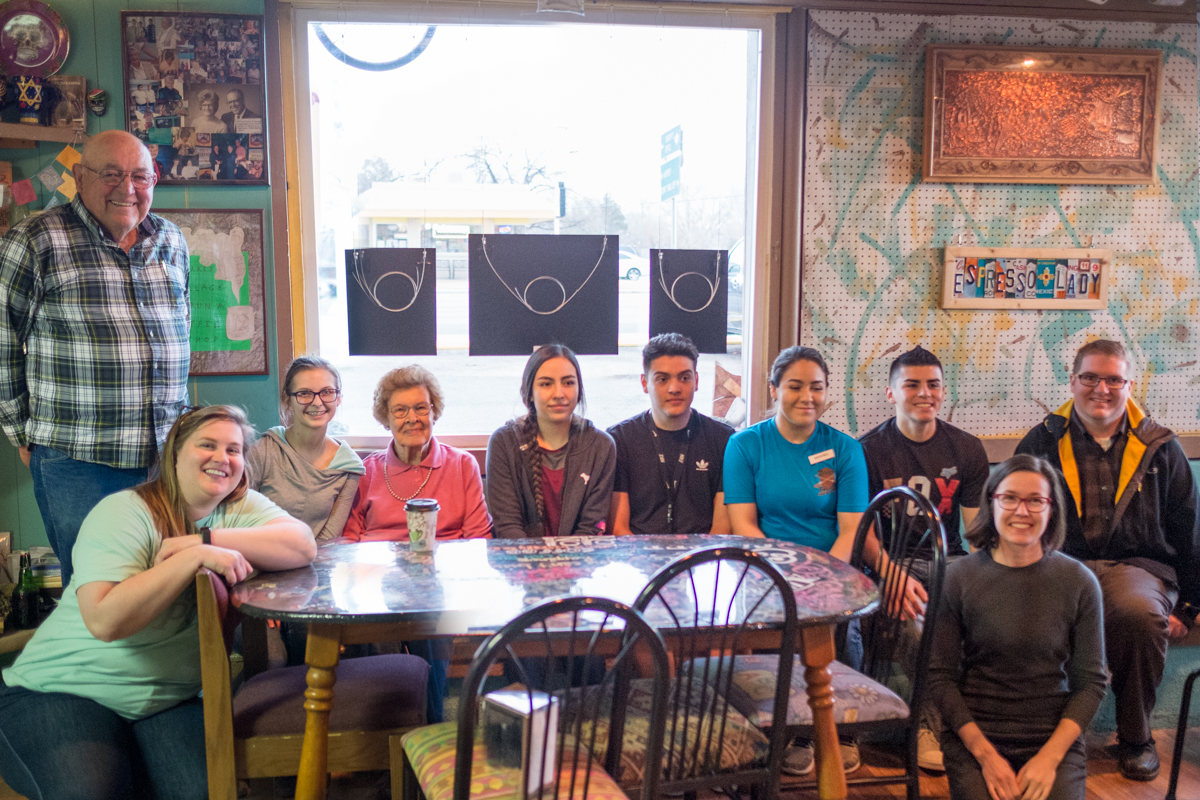 Some of the participants in Senior Spotlight, back row, from left: Coombs Hall, Lindsey McFarlane, Gladys May, Daniela Mendez, Roman Medina, Maribel Escalante, Freddy Escalante, and teacher Craig Gowans. Front: Maria Sykes (Epicenter Director) and Jamie Horter (Frontier Fellow). Not pictured: student Marcela Soto and interviewed seniors Dean and Hilda King, Ardon and Carolyn Sherril, and Catherine Kane.