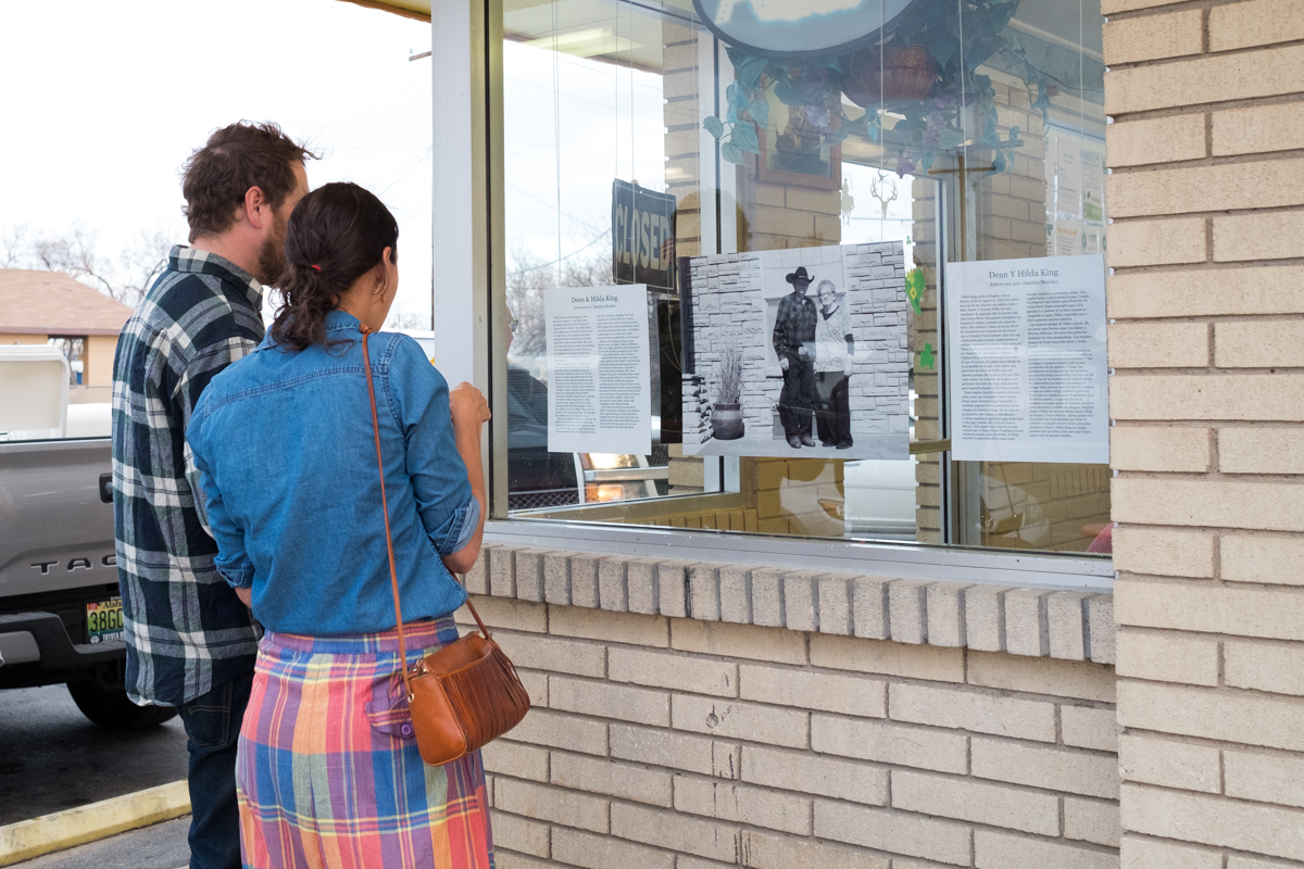 Green River locals stop to read stories about the senior citizens in their community.