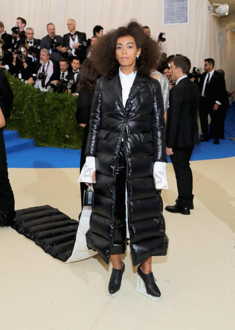 Solange Knowles in Thom Browne, Mark Cross Purse, and Piaget Jewelry.