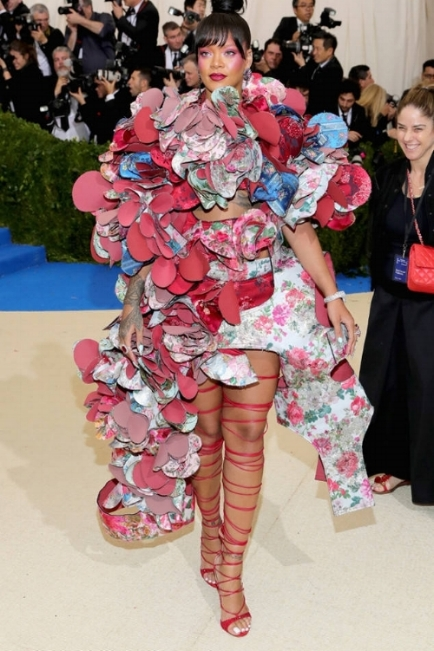 Rihanna in a Comme des Garçons dress, Chopard Jewelry, and Dsquared 2 shoes.